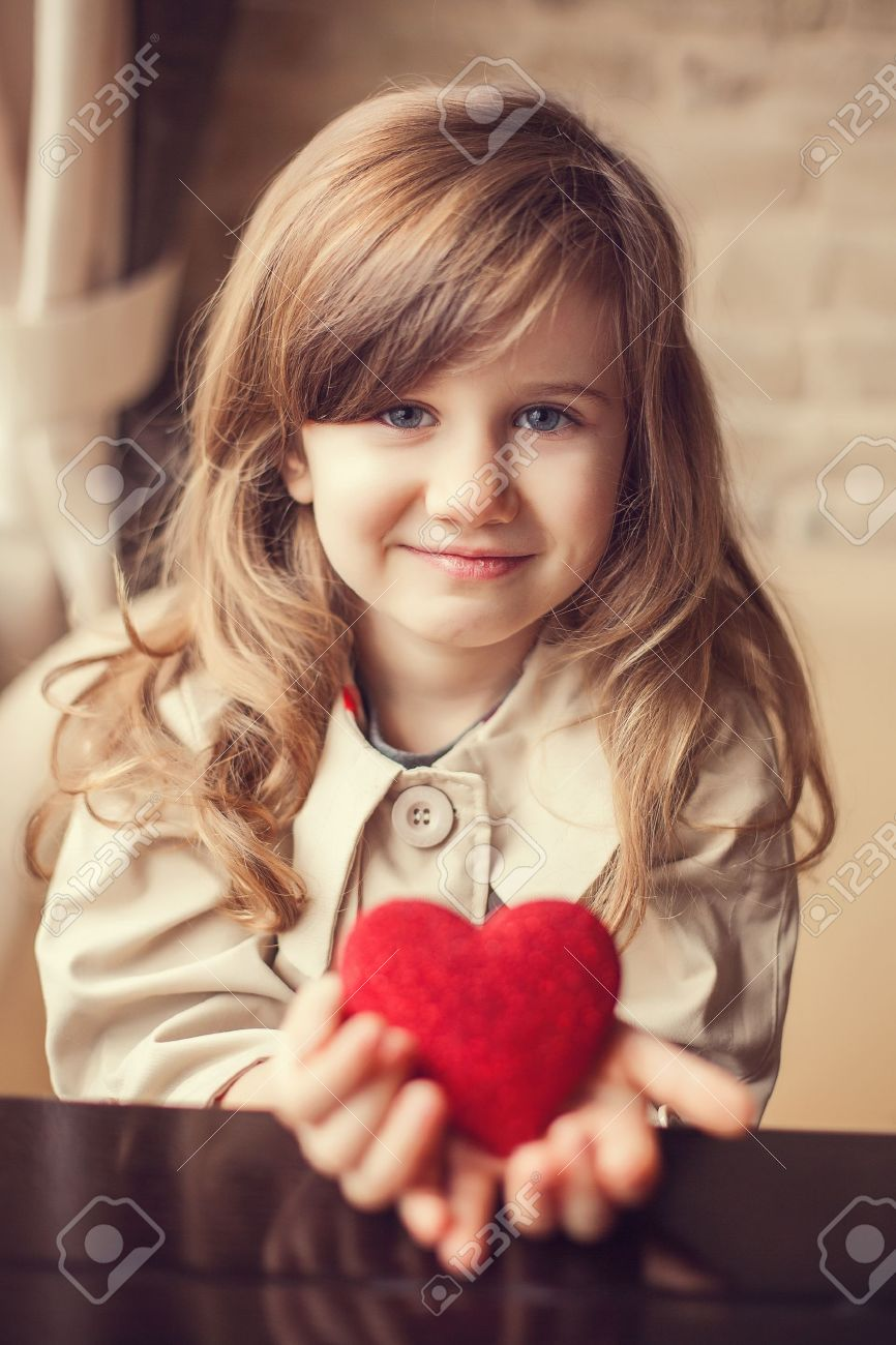 Valentine Day - dreaming cute child with red Heart in hands. - 17809991