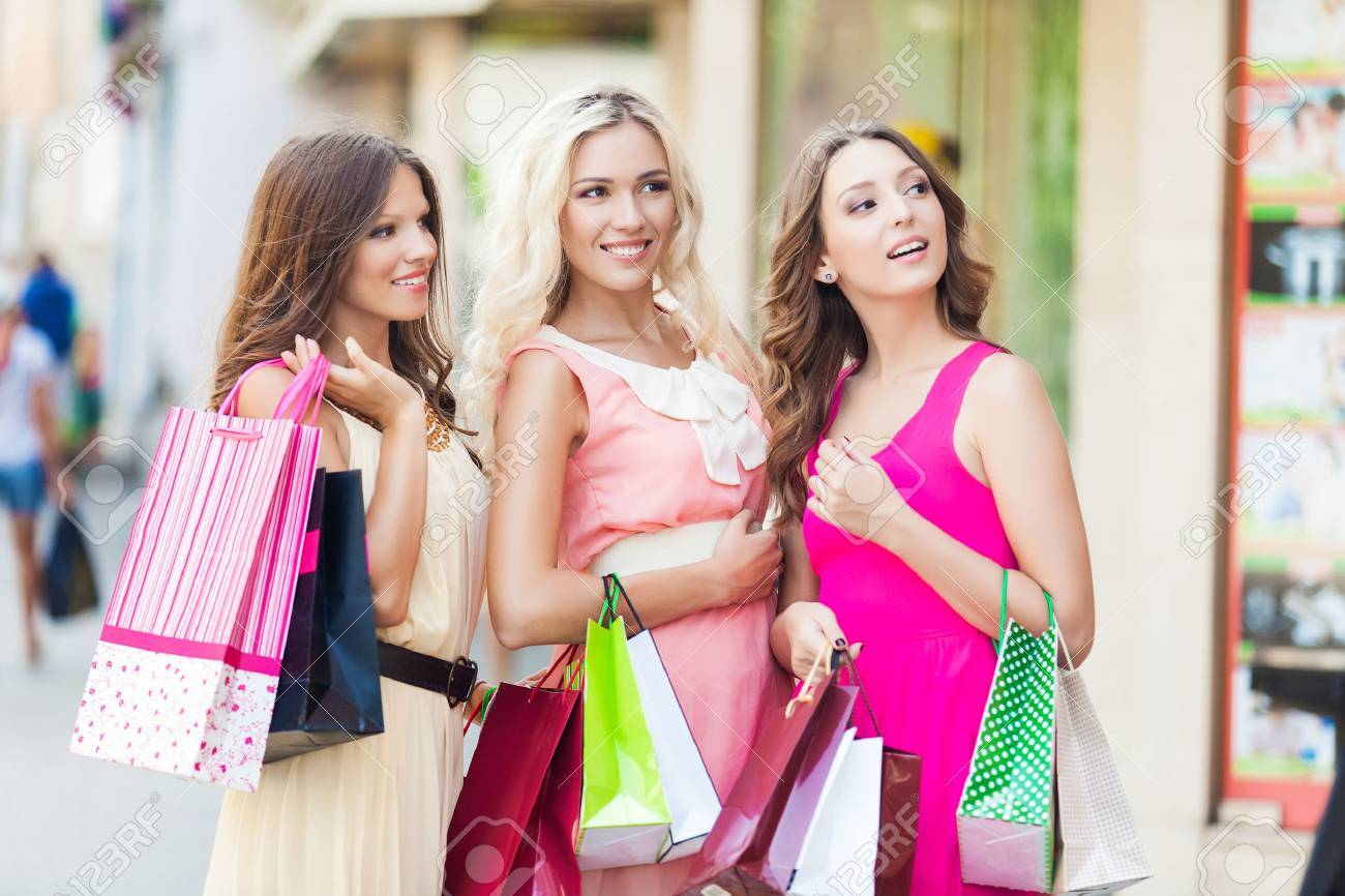 Three beautiful girlfriends with with Shopping Bags - 22582241