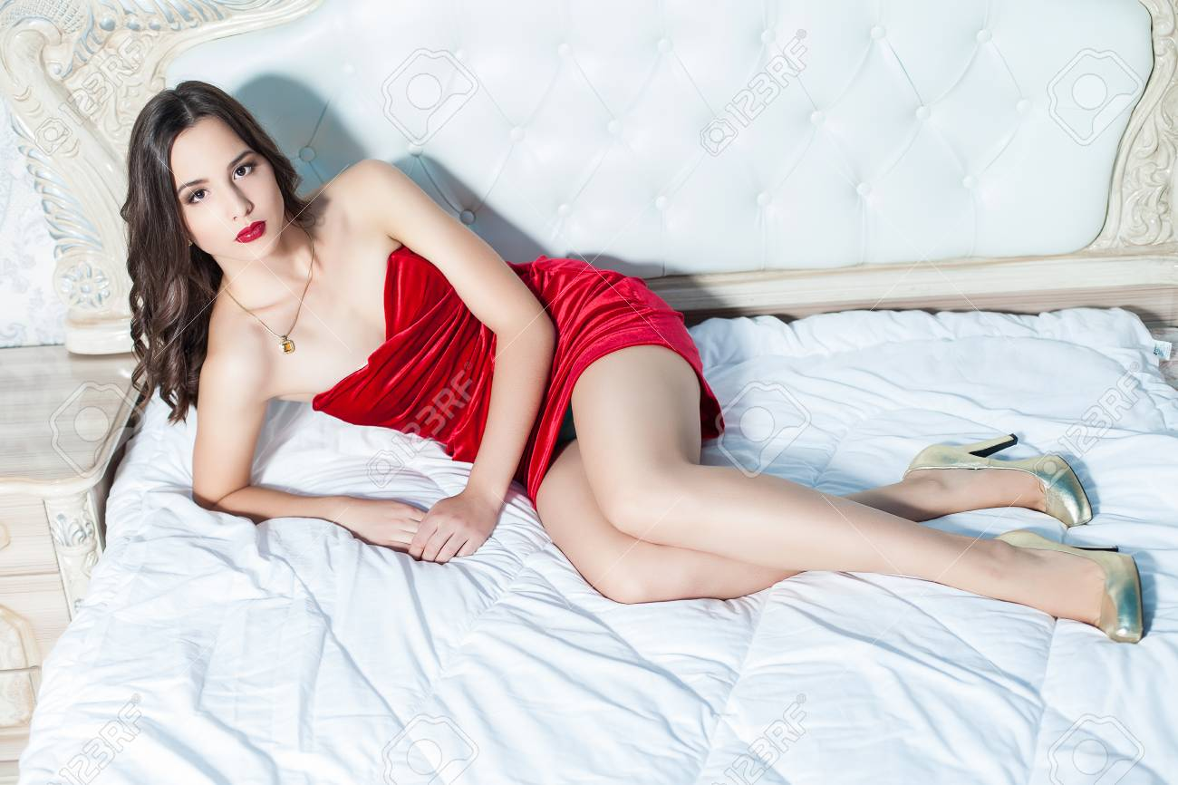 Fashion portrait of elegant young woman in a luxurious interior Stock Photo - 23239559