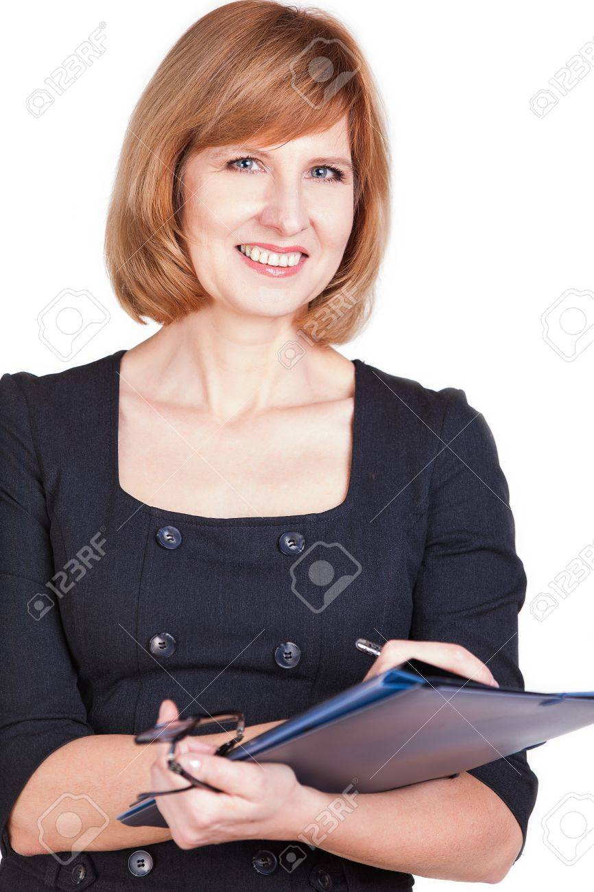 Portrait of a smiling businesswoman holding paperwork isolated on a white background. - 25447115