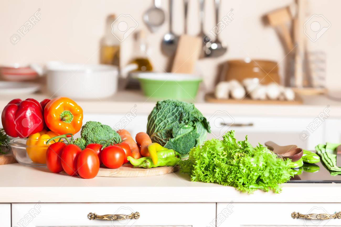 healthy foods are on the table in home kitchen - 32091316