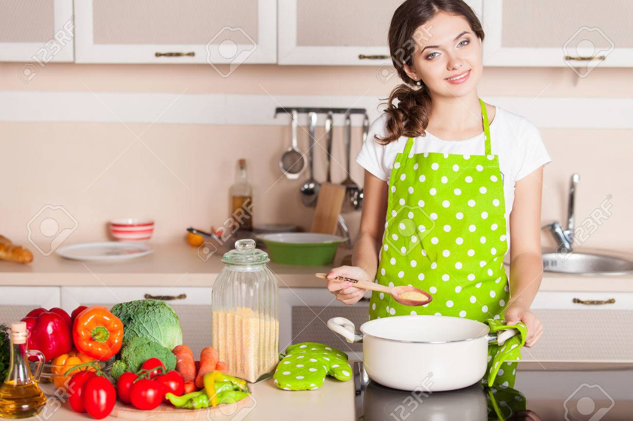 young woman cooking in the kitchen healthy food dieting concept