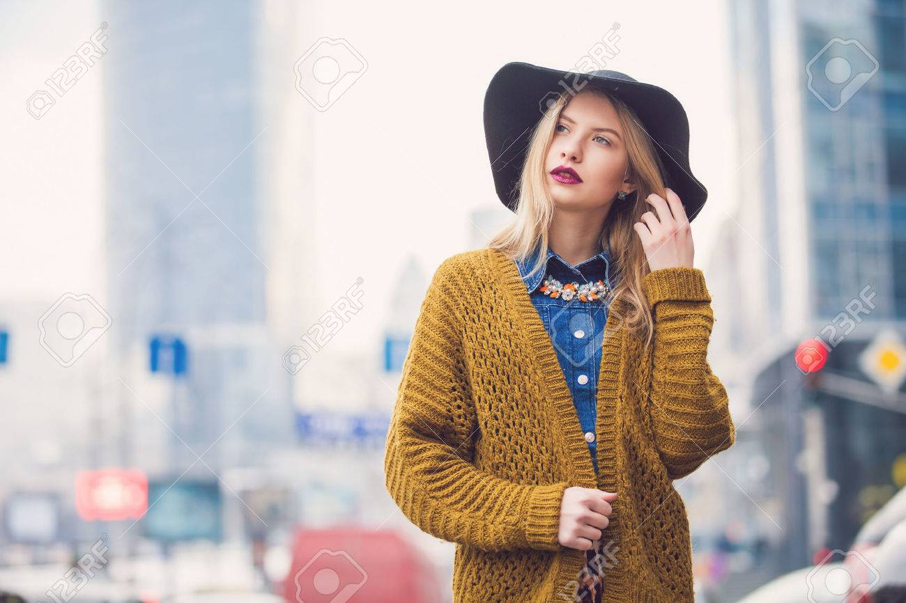 Fashionable young woman posing outside in a city street. Winter Fashion - 46896341
