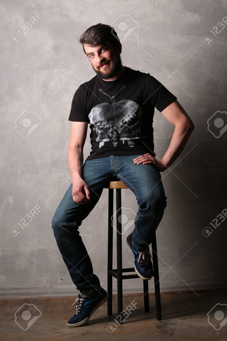 Awesome Bearded Man In Black T Shirt With Sitting On A Bar Stool Creativecarmelina Interior Chair Design Creativecarmelinacom