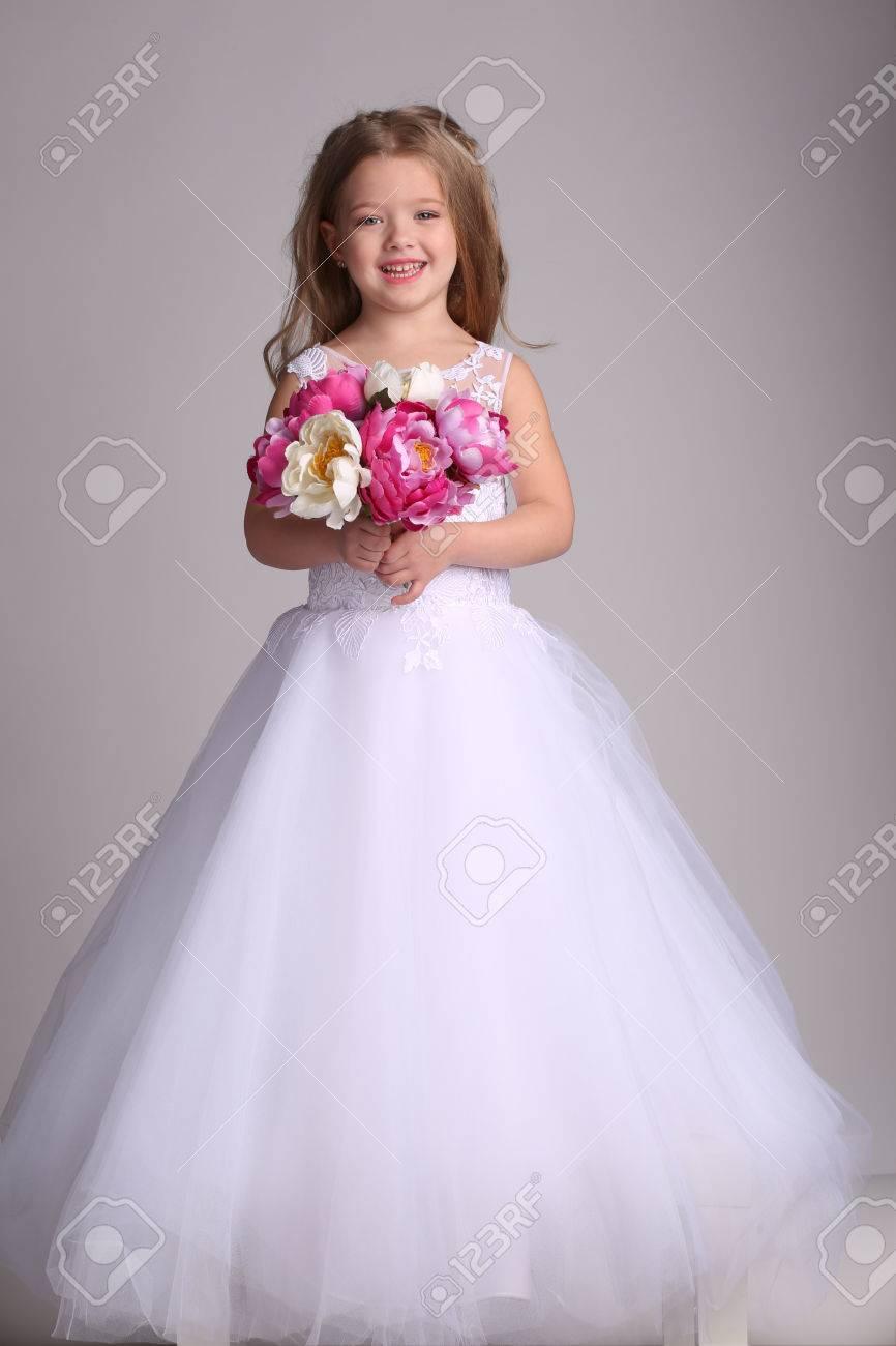 Little Girl In Wedding Dress With Bunch Of Flowers, Little Bride ...