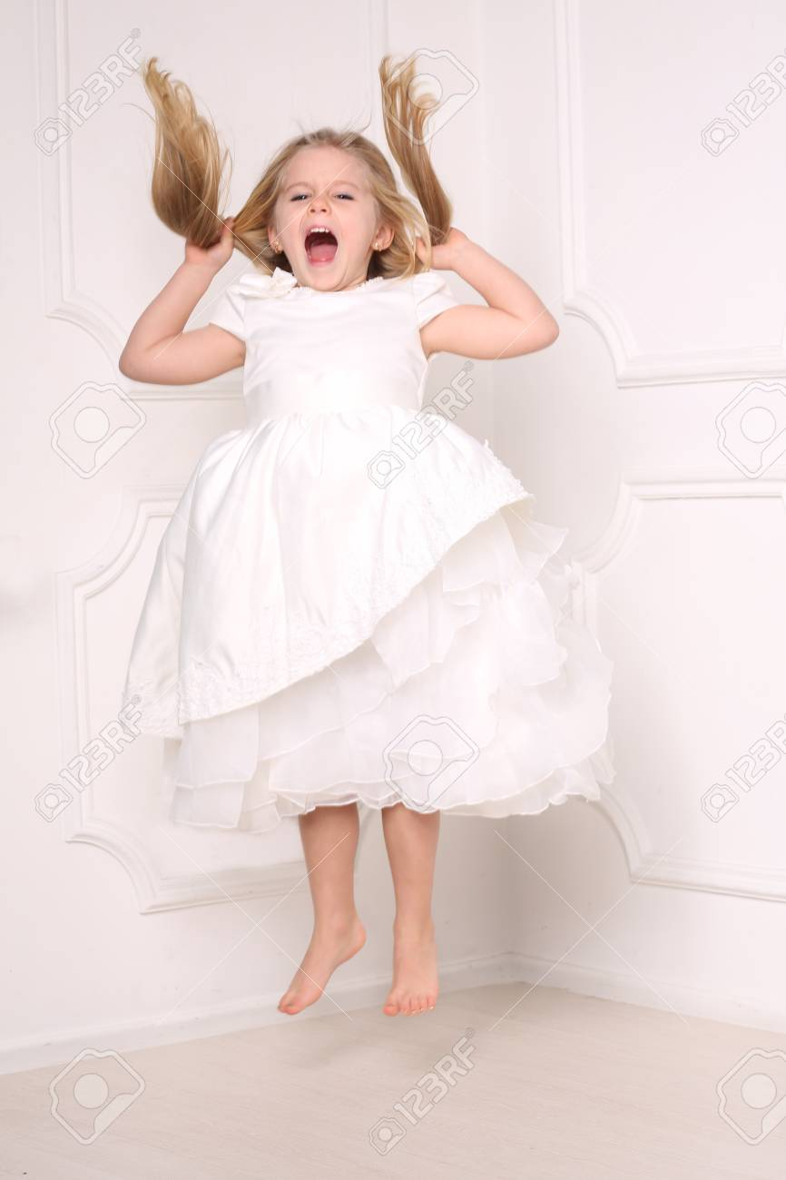 Screaming Girl Jumping And Holding Her Hair, Girls Dresses, Kids ...