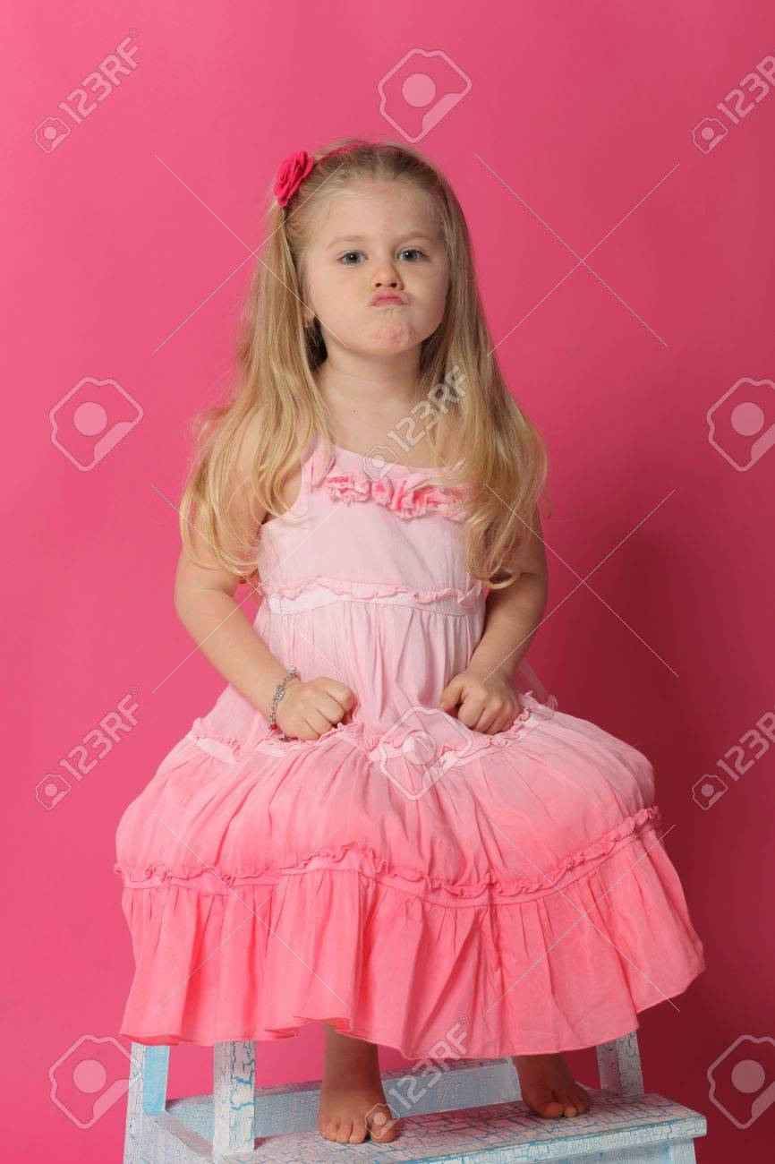 little girl pouting, old furniture, grimace baby, cute baby,.. stock