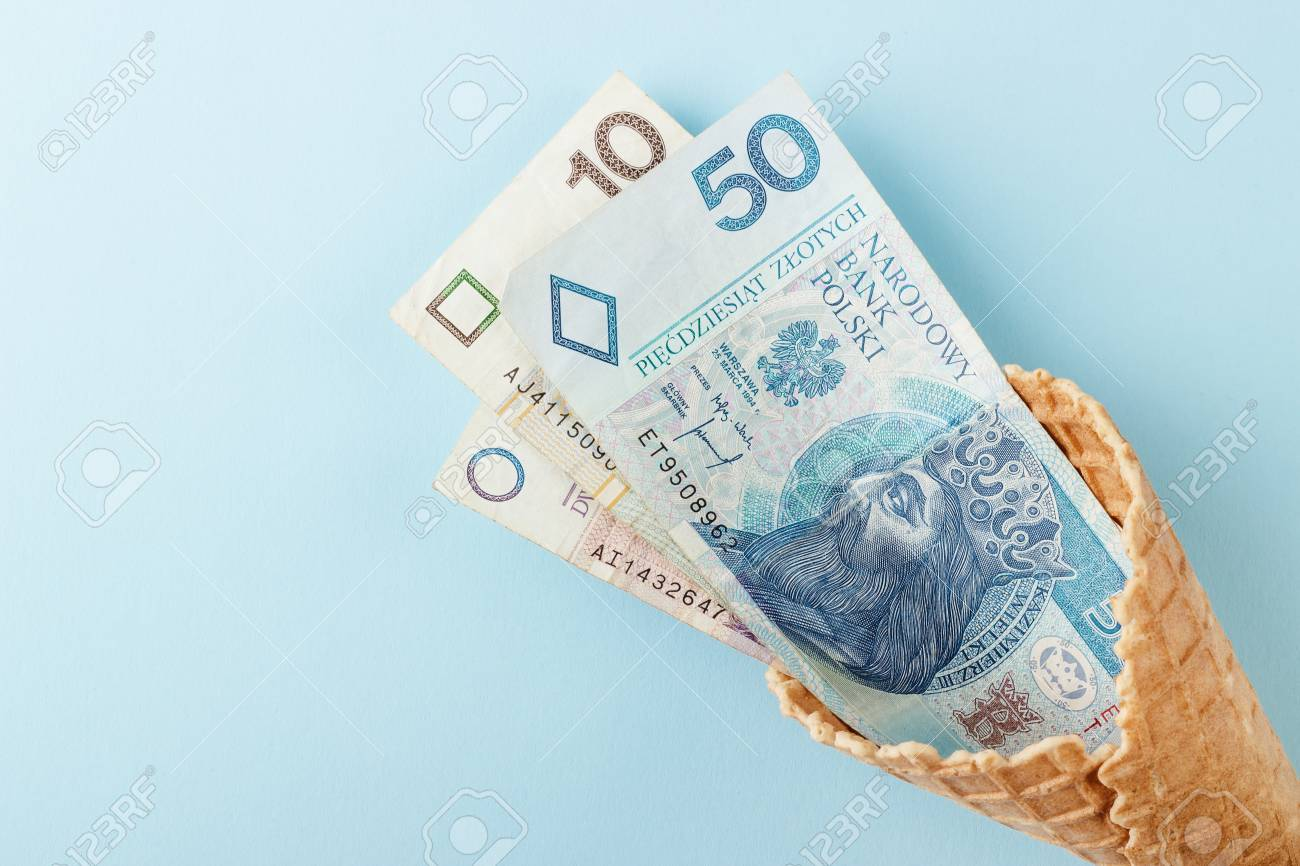 Monetary Signs Polish Zloty On A Blue Paper Background And