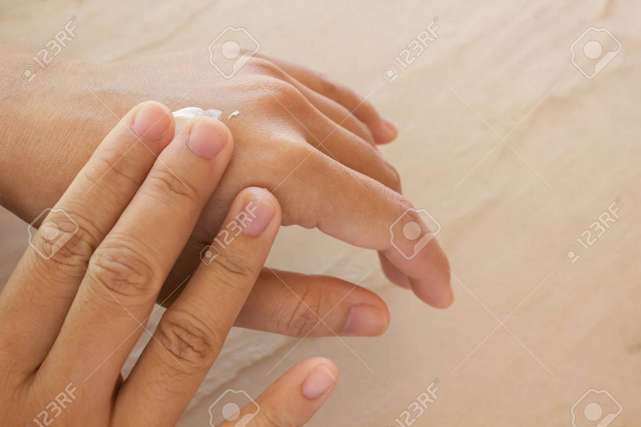 Women dry hands, apply skin care or lotion - 53454353