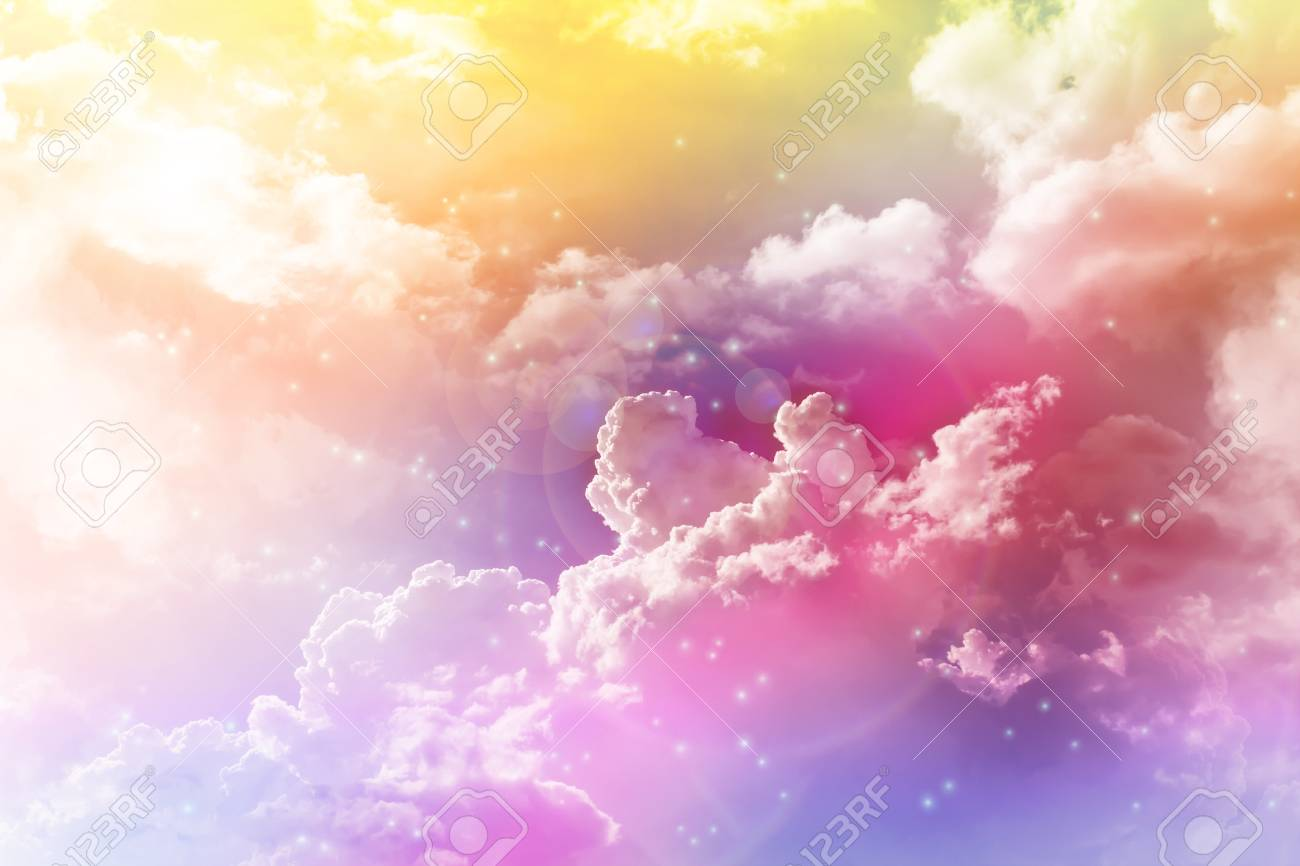 colourful dreamy big puffy clouds sky with romantic lense flare