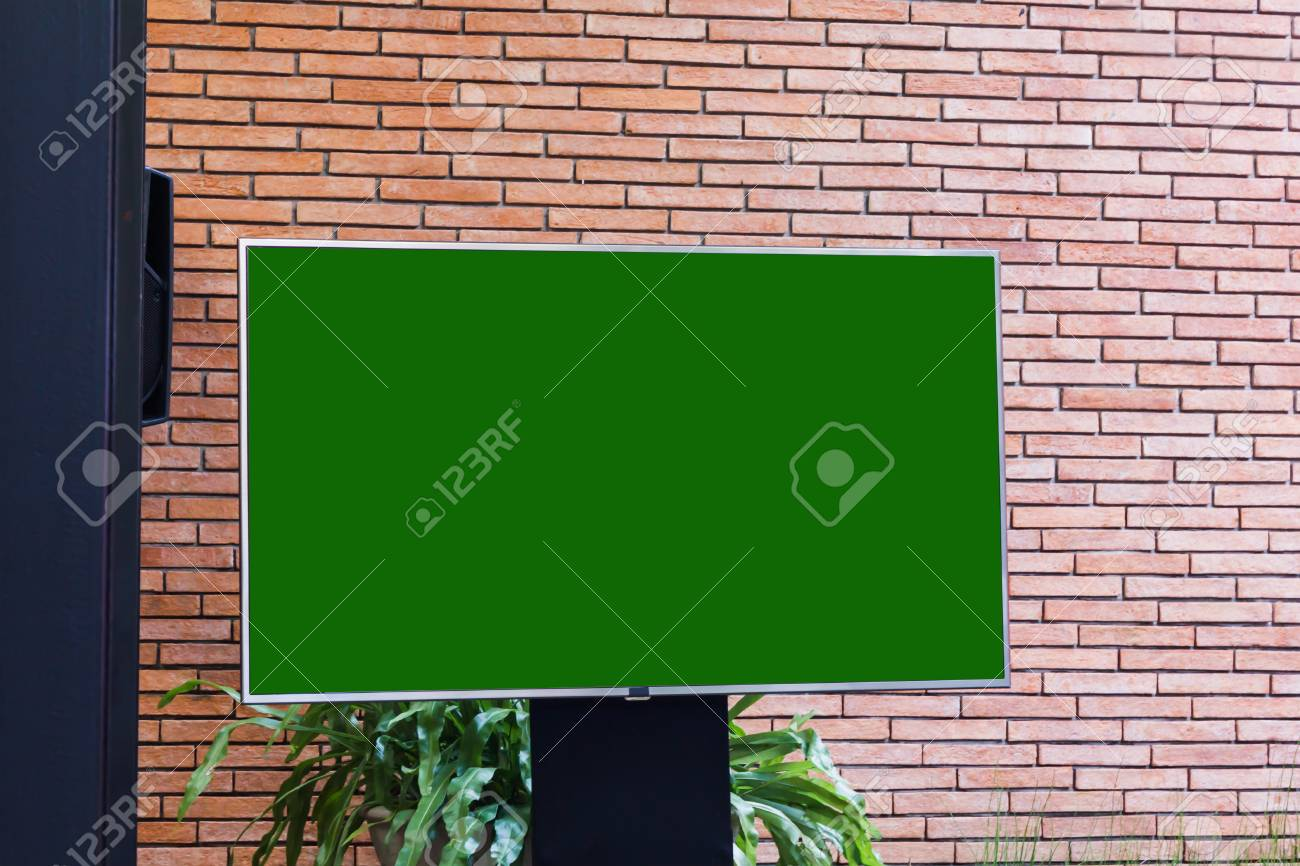 Big empty blank green screen LED television with stand