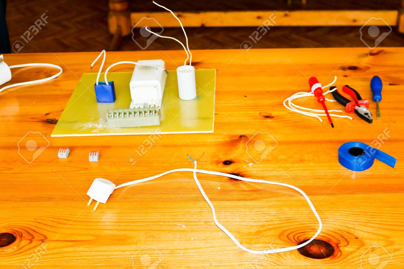 Electrical Circuit With Wires And Spare Parts Installation Of An Electric Equipment Pliers Blue Tape