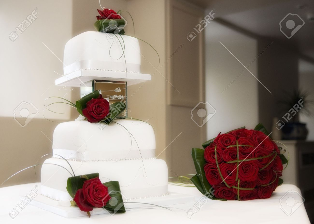 Beautiful Wedding Cake And Red Roses Stock Photo Picture And