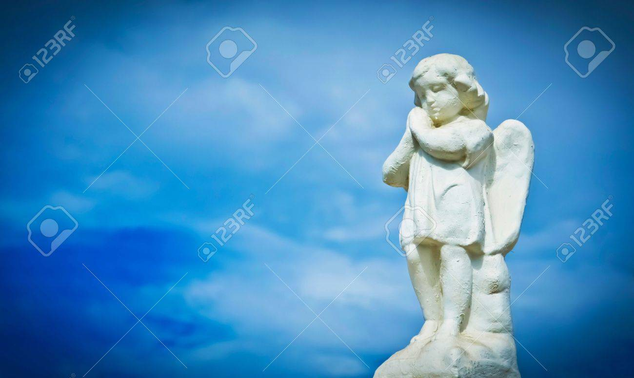 Praying sculpture angel on cloud background. Stock Photo - 11983575