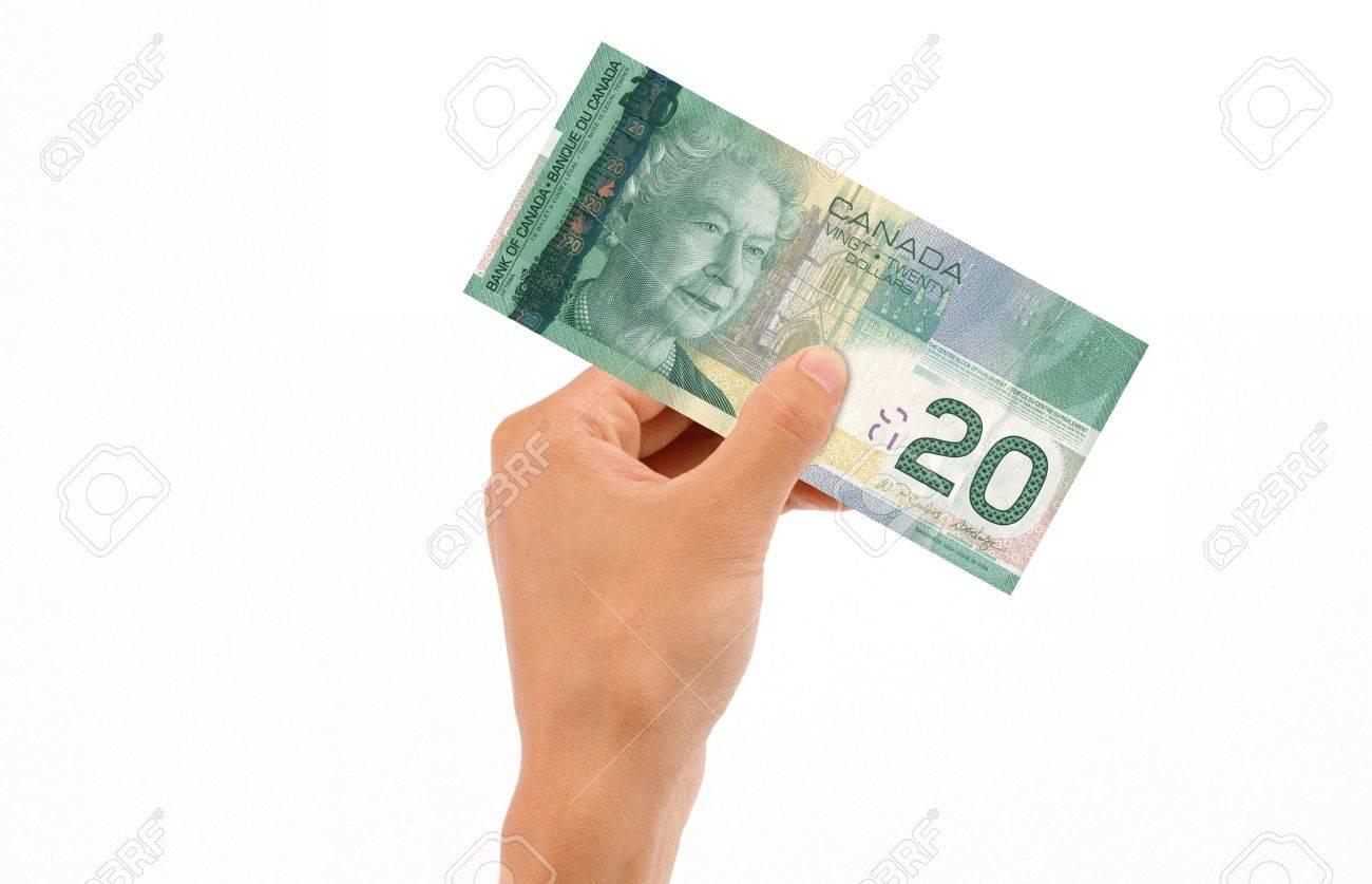 Hand holding 20 Canadian Dollar Bill islolated on white background. Stock Photo - 11983577
