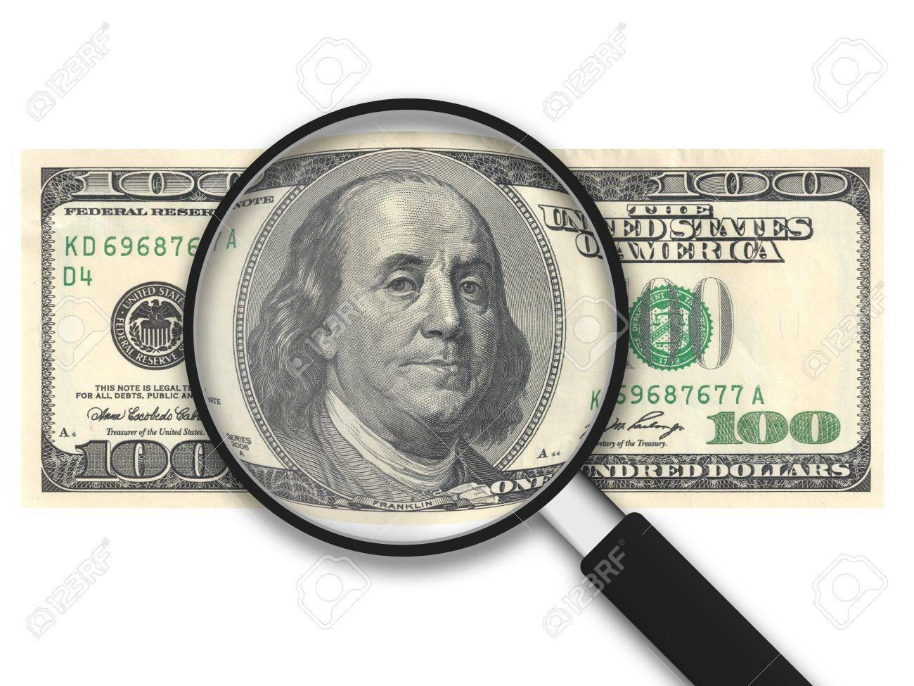 Lupa con 100 dólares de los Estados Unidos Nota sobre fondo blanco Foto de archivo - 11983639