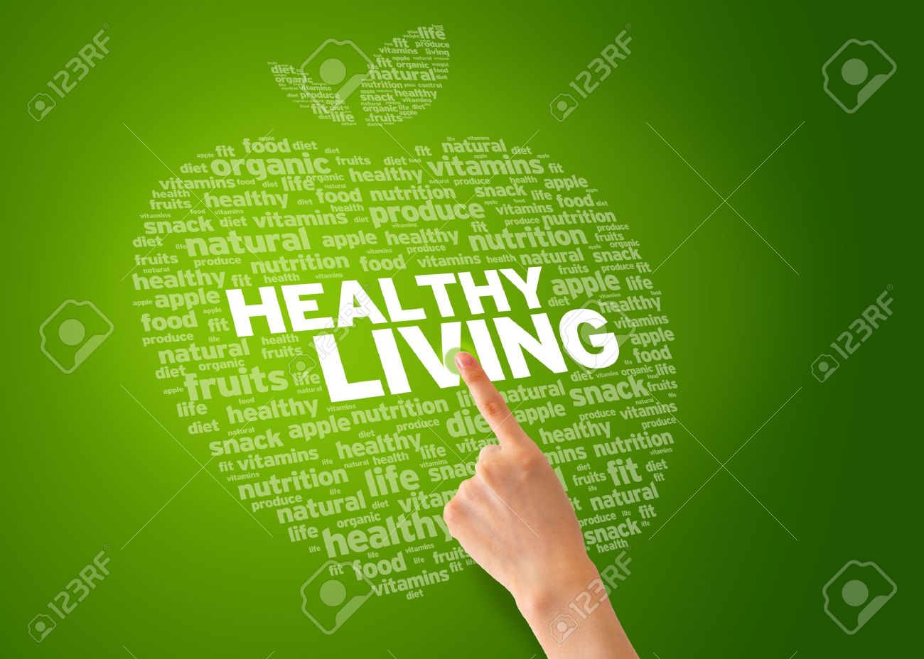 Finger pointing at an Healthy Living Apple on green background. Stock Photo - 12721433