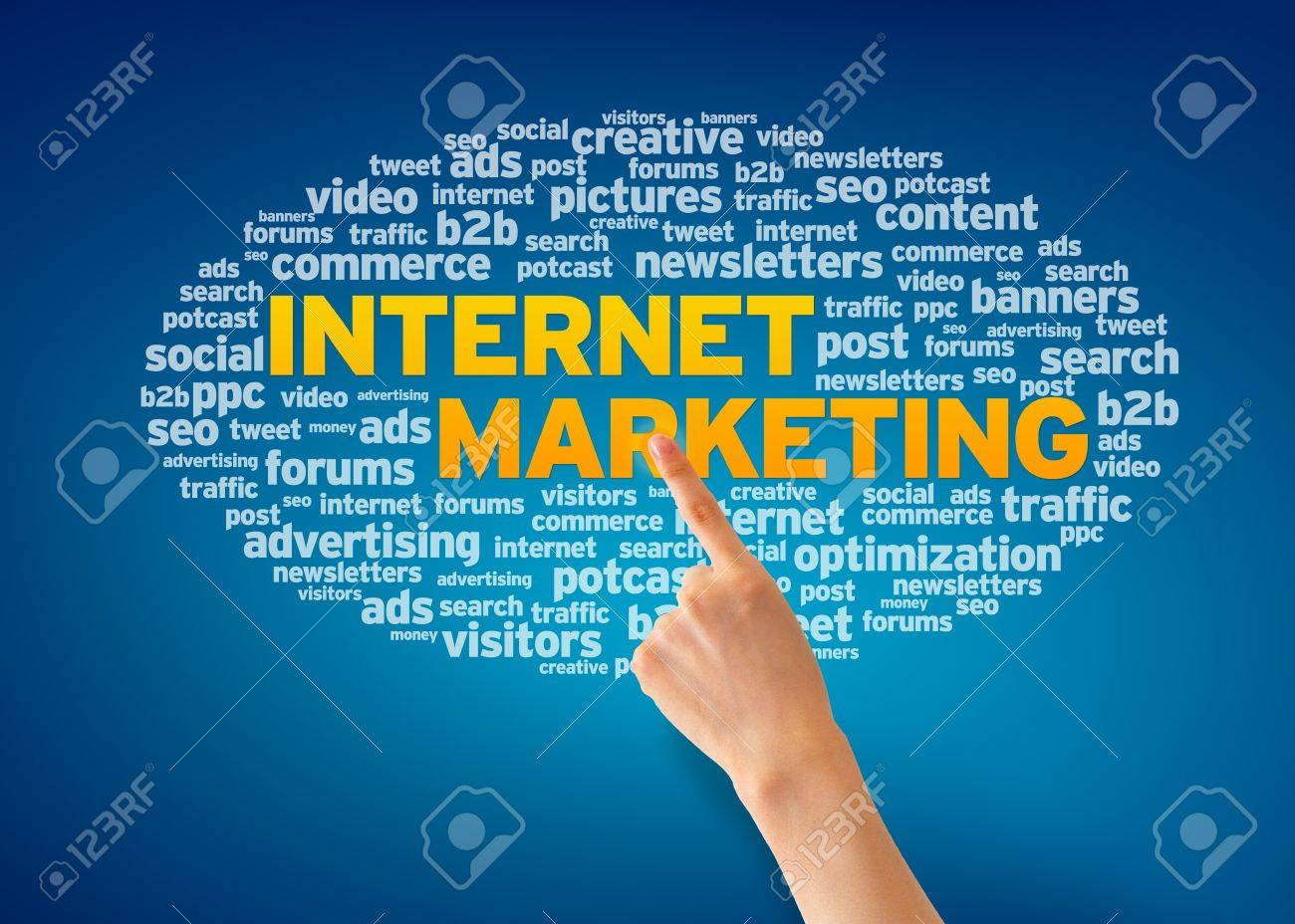 Hand pointing at an Internet Marketing word cloud on blue background Stock Photo - 13428471