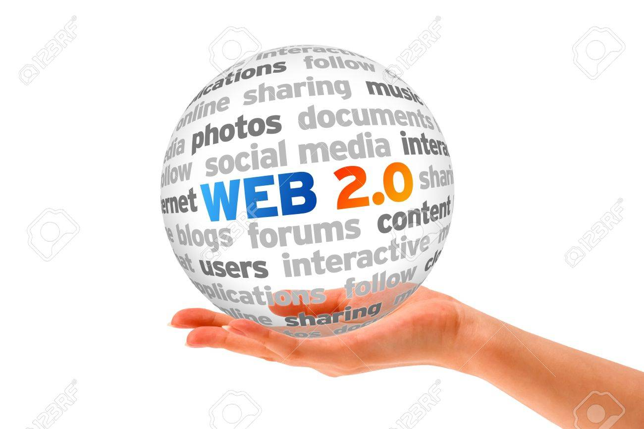 Hand holding a Web 2.0 Word Sphere on white background. Stock Photo - 14363544