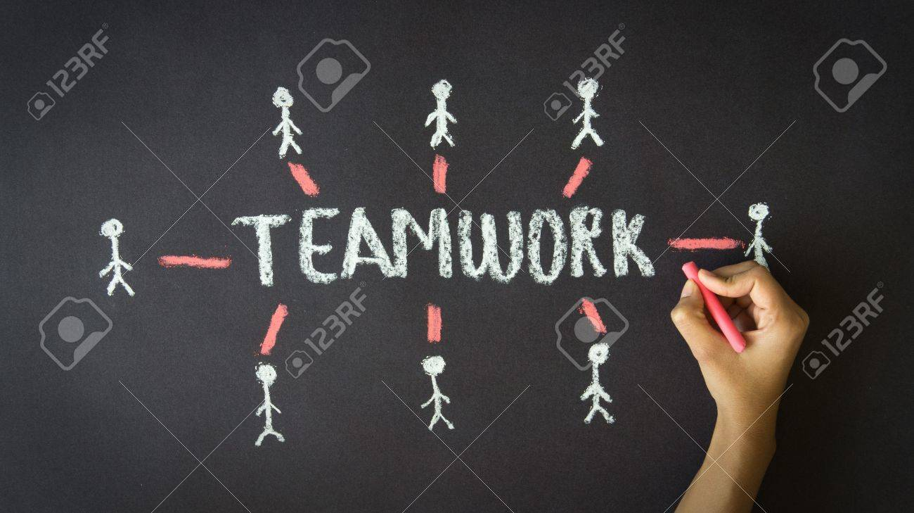 A person drawing a Teamwork Illustration with chalk on a blackboard. Stock Illustration - 19109835