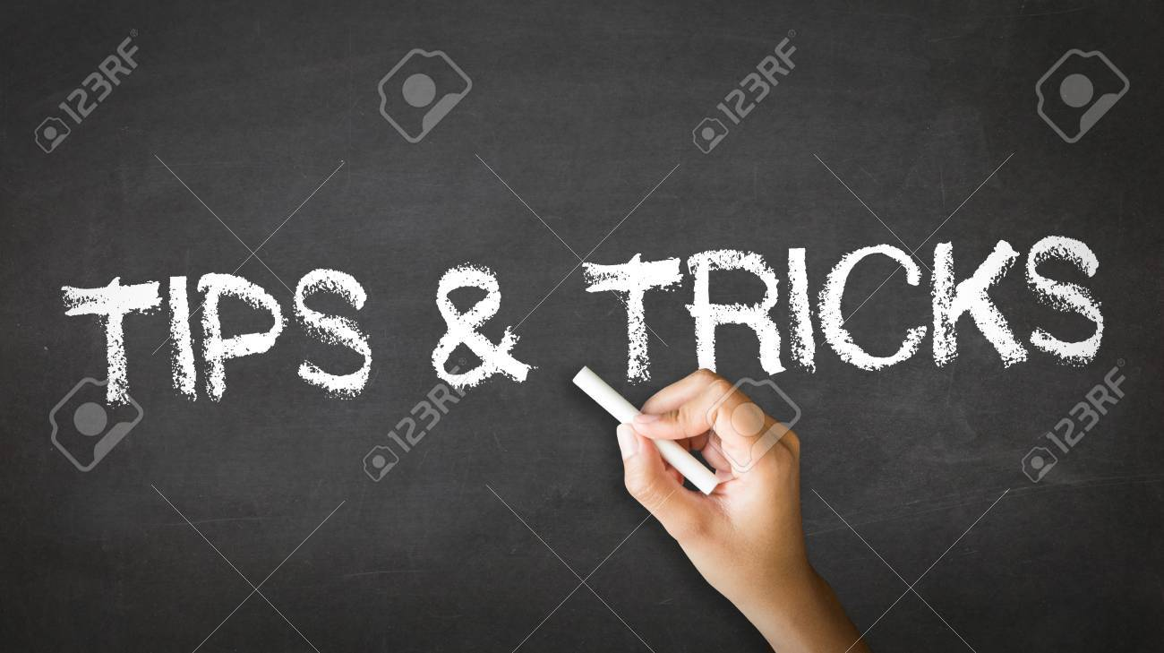 A person drawing and pointing at a Tips and Tricks Chalk Illustration Stock Photo - 21219328