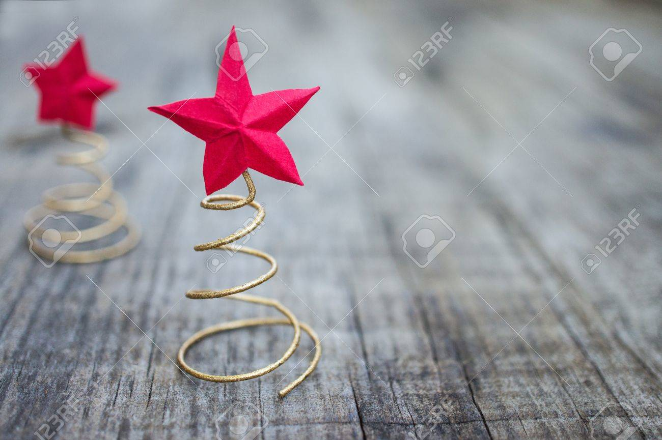 Concept of Red Christmas Stars on wooden background - 21960862