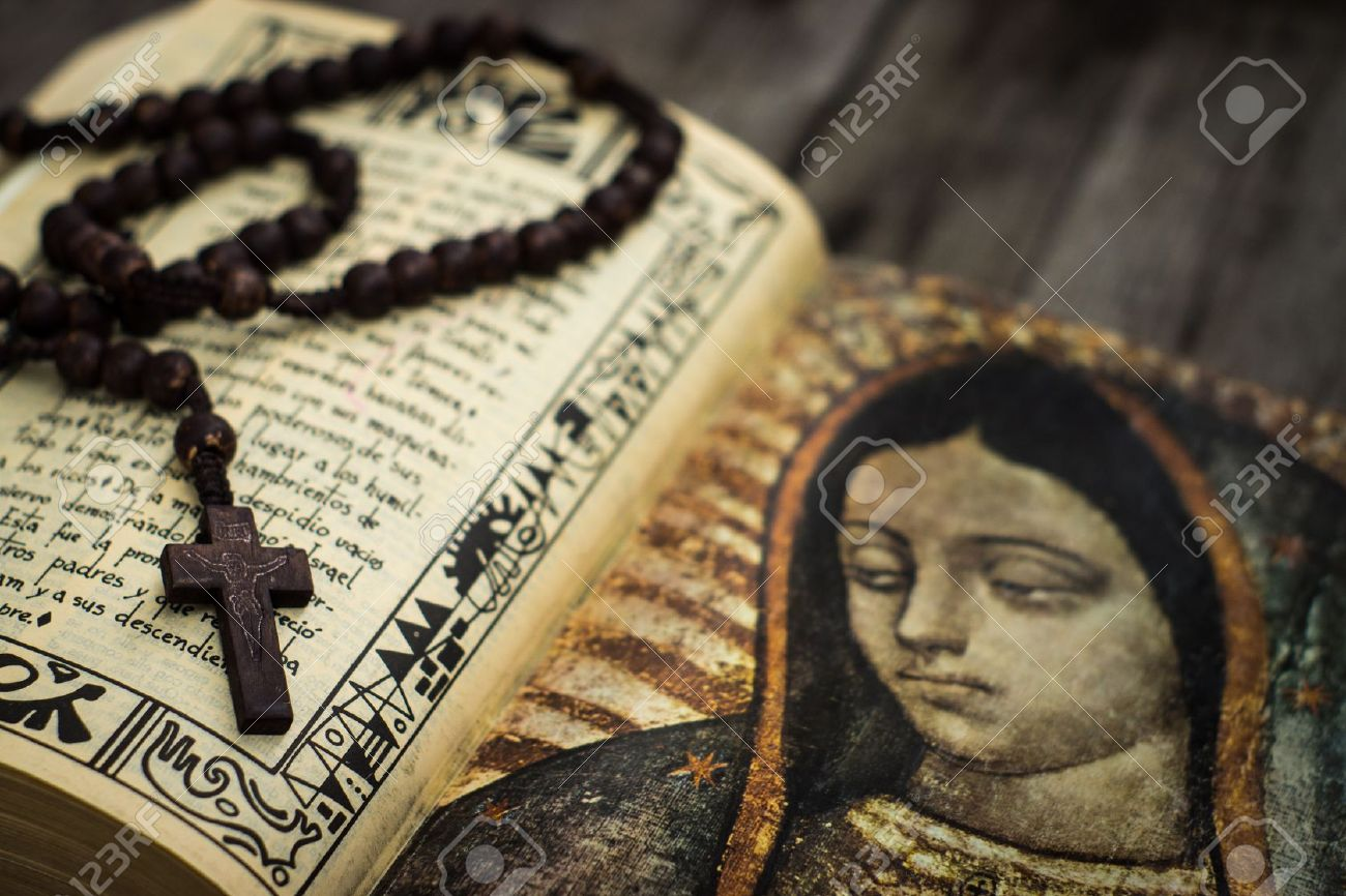 A Religious concept of a rosary and a bible on wood background - 22133843
