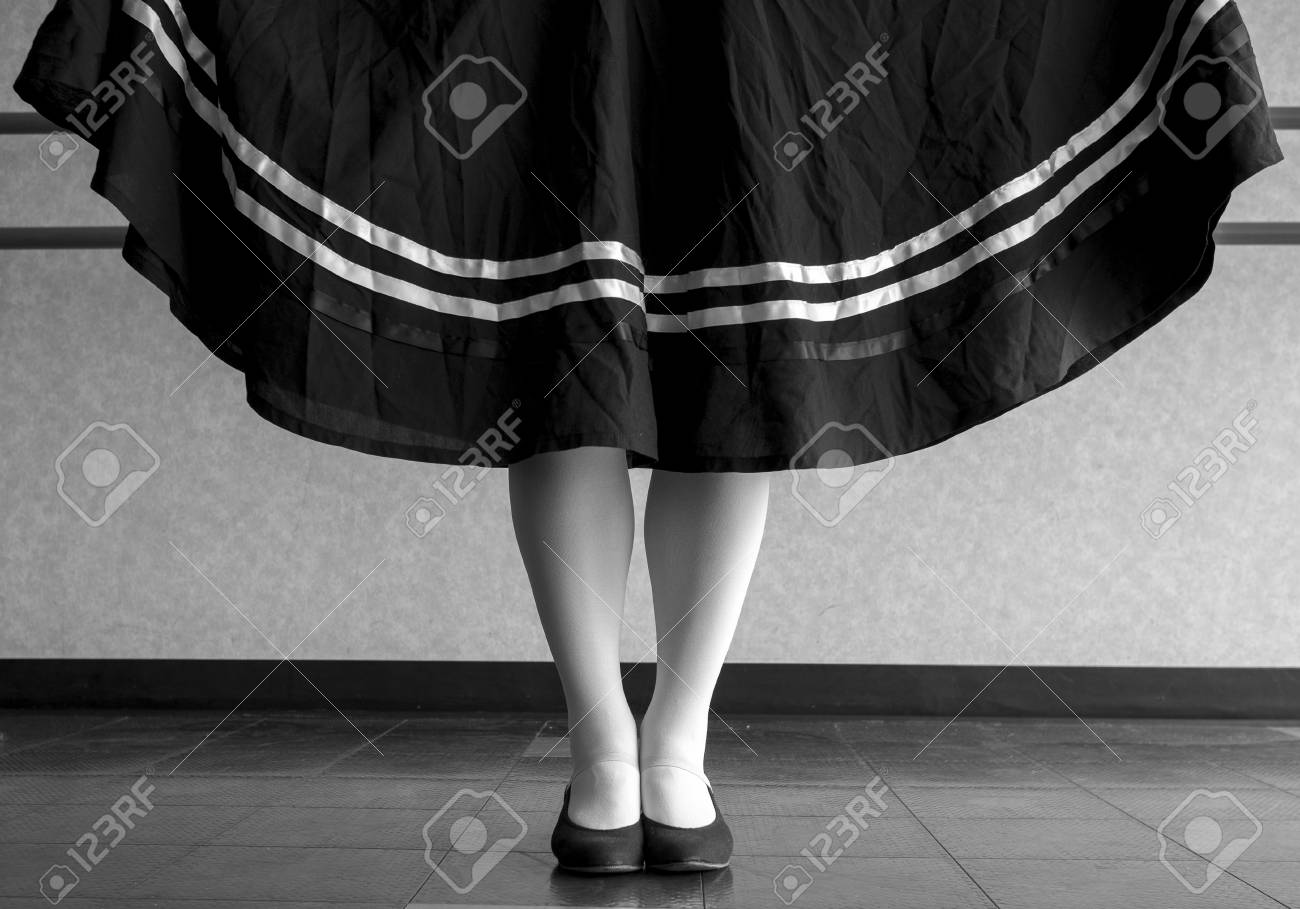 Black and white version of traditional dancer holding her character