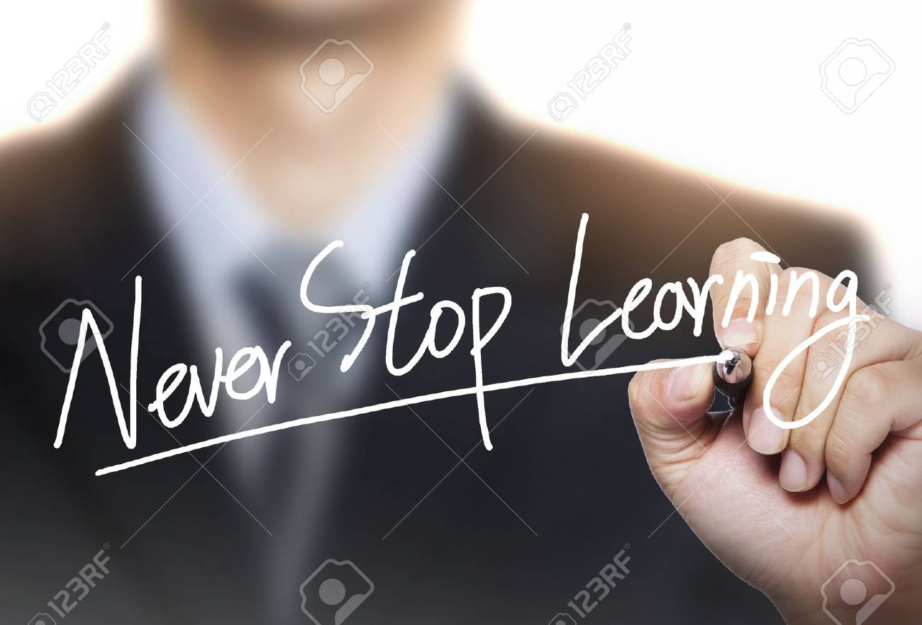 never stop learning written by hand, hand writing on transparent board, photo - 65776554