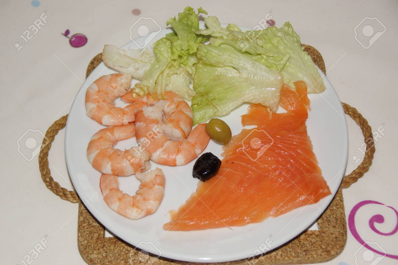 A Plate With A Slice Of Smoked Salmon A Black Olive And A Green Stock Photo Picture And Royalty Free Image Image 143864274