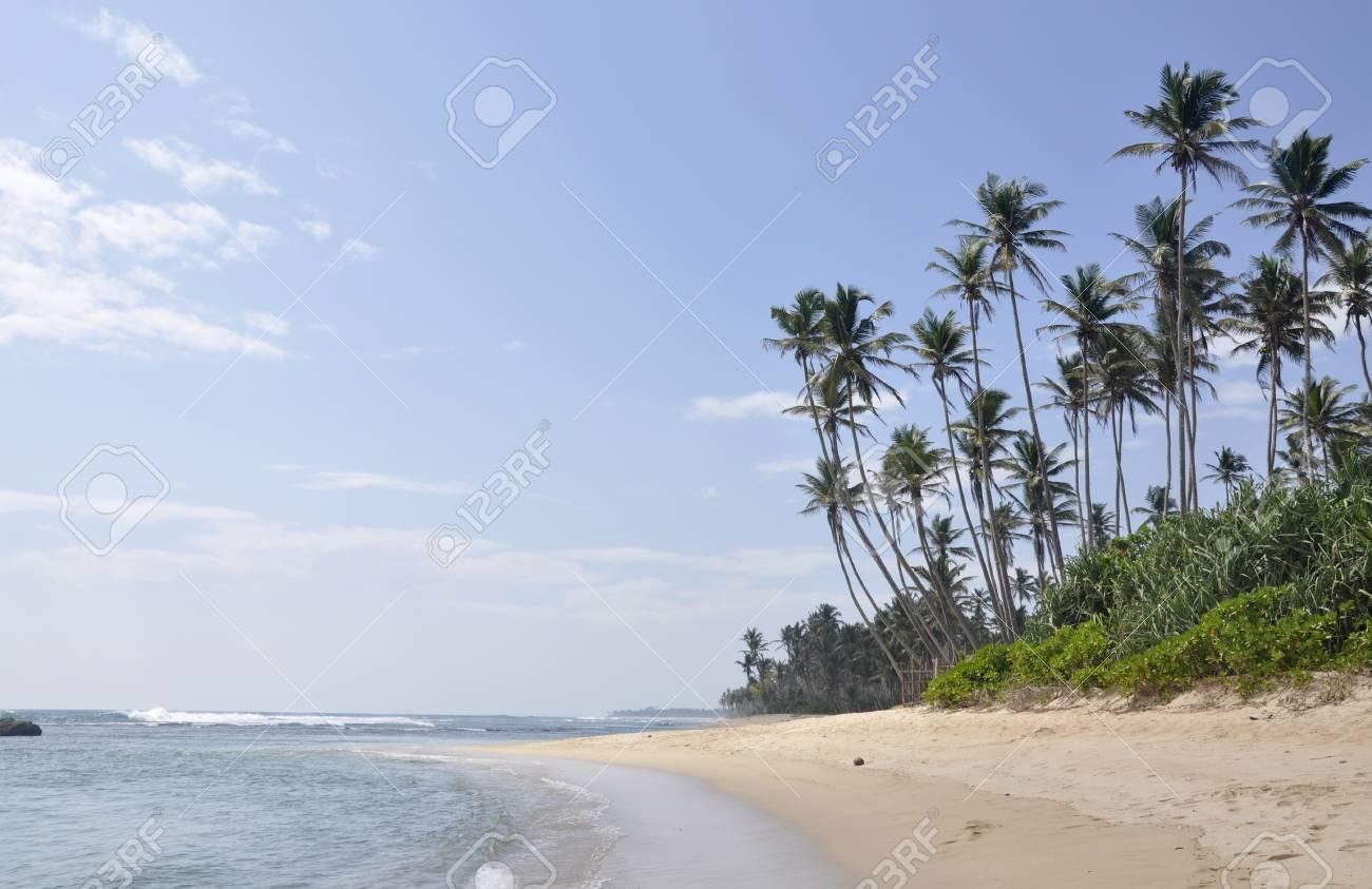 A bright sunny day at the beach at Polhena, Sri Lanka Stock Photo - 12632141