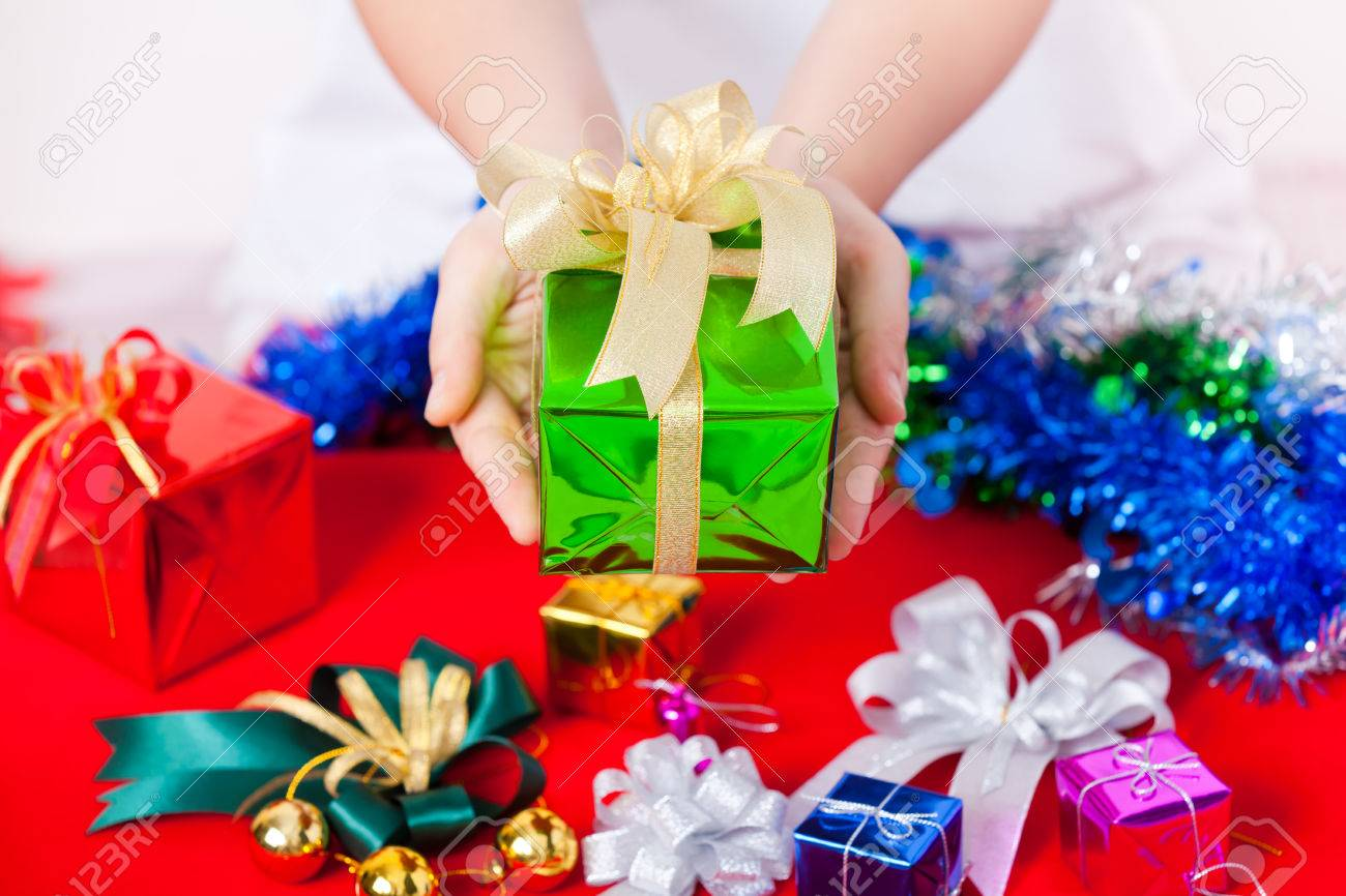 celebration theme with merry christmas happy new year gifts lady hand showing beautiful gift