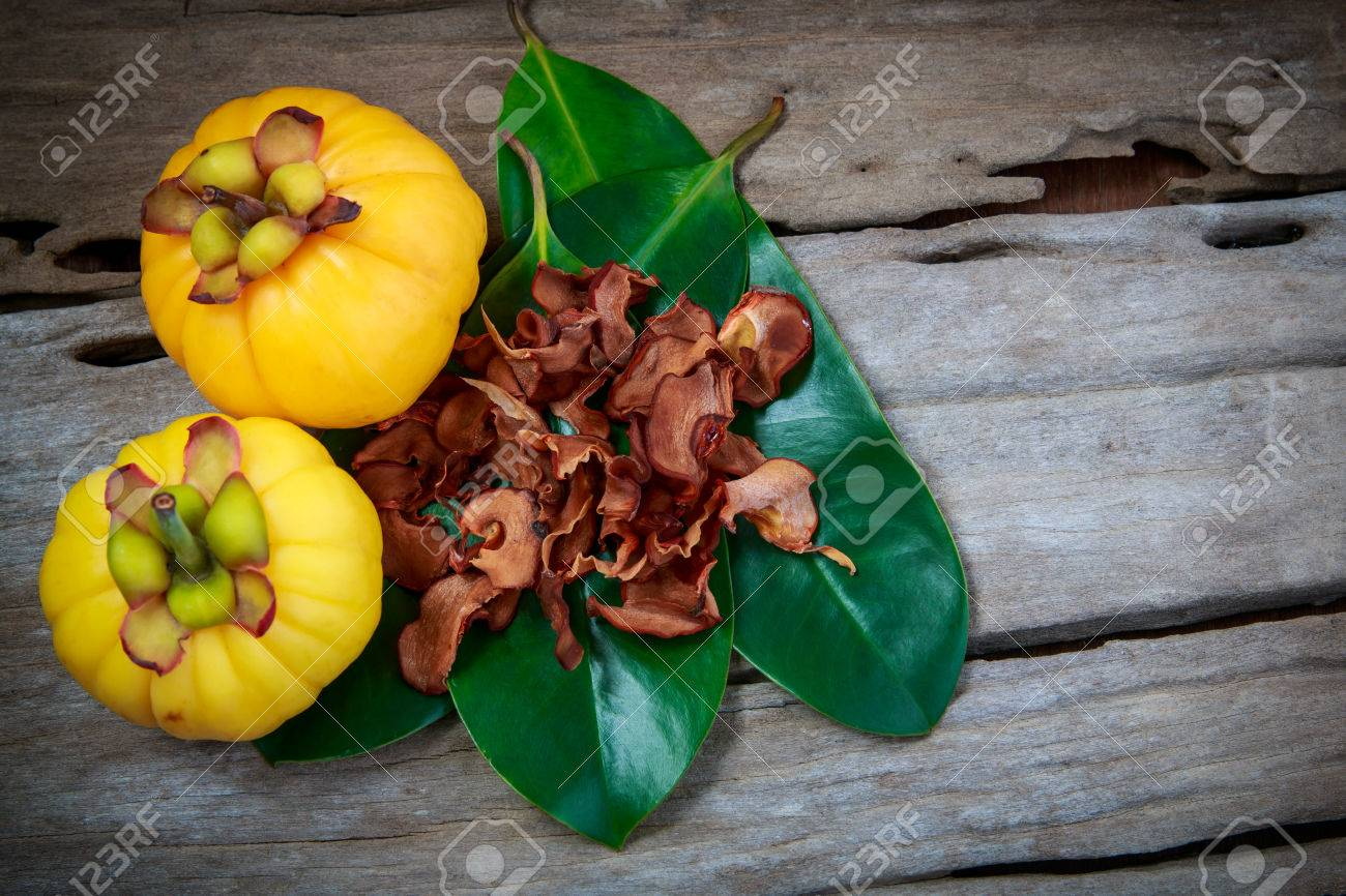 Top View Garcinia Cambogia Fresh Fruit On Wood Background Dry