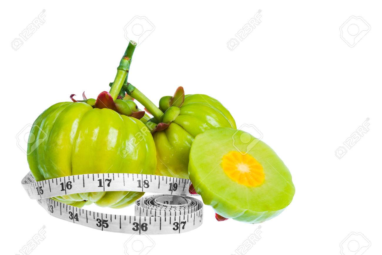 Garcinia Cambogia Fresh Fruit With Measuring Tape Isolated On