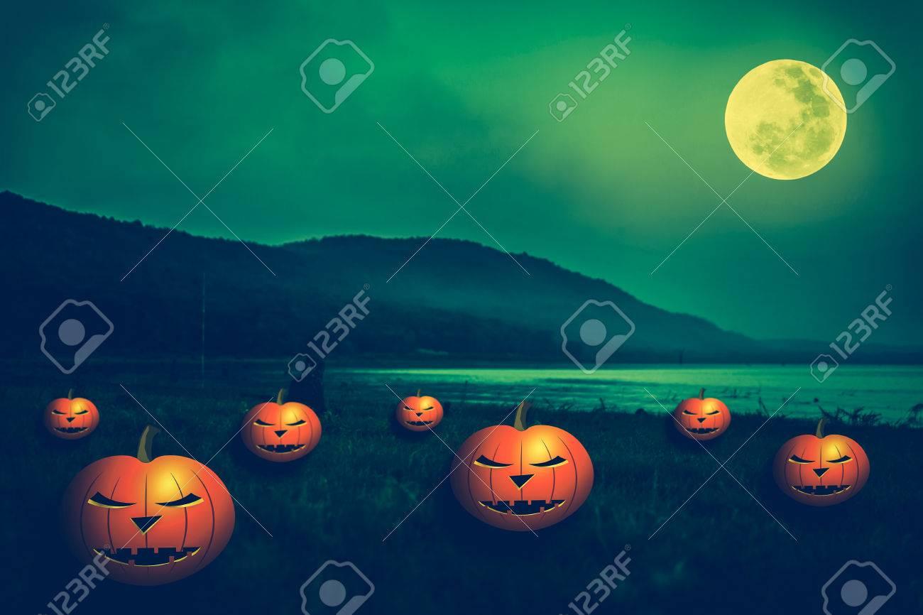Mountain and beautiful full moon, outdoors at night. Pumpkins..