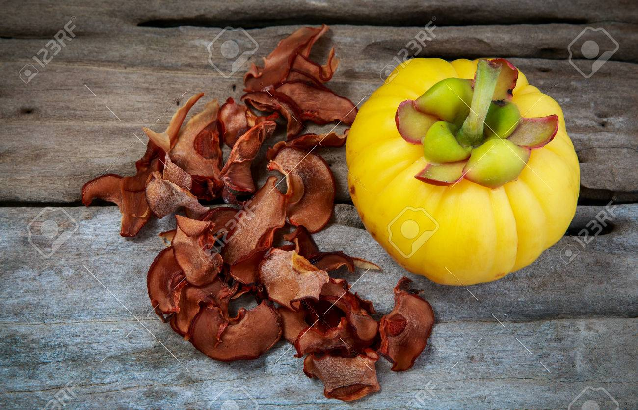 Top View Garcinia Cambogia Fruit And Dry Garcinia On Wood