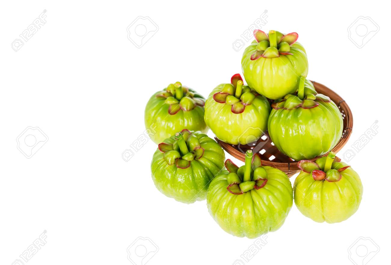 Garcinia Cambogia Fresh Fruit On Wood Basket Isolated On White