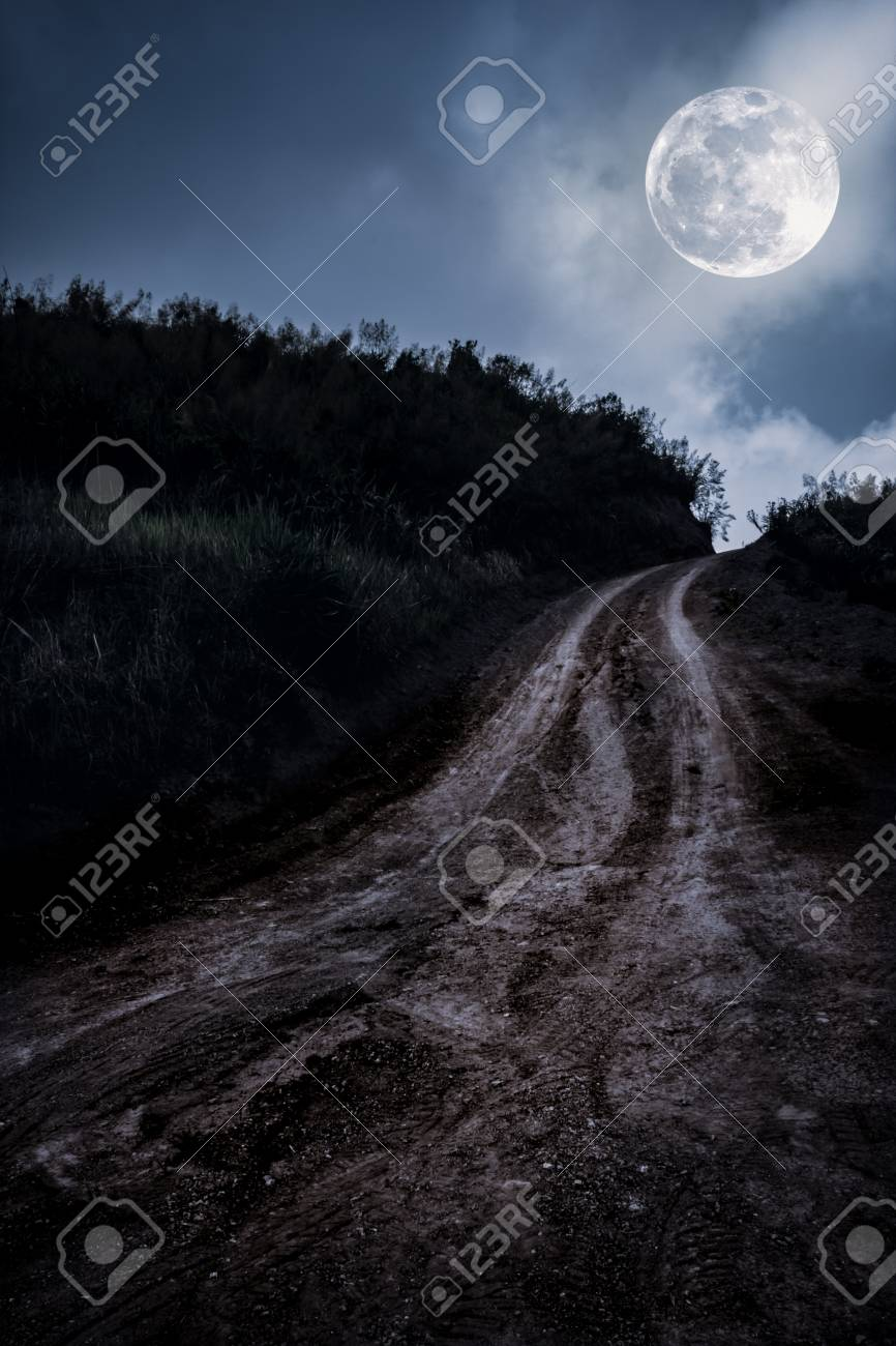 Landscape in nature of beautiful full moon with tire tracks on