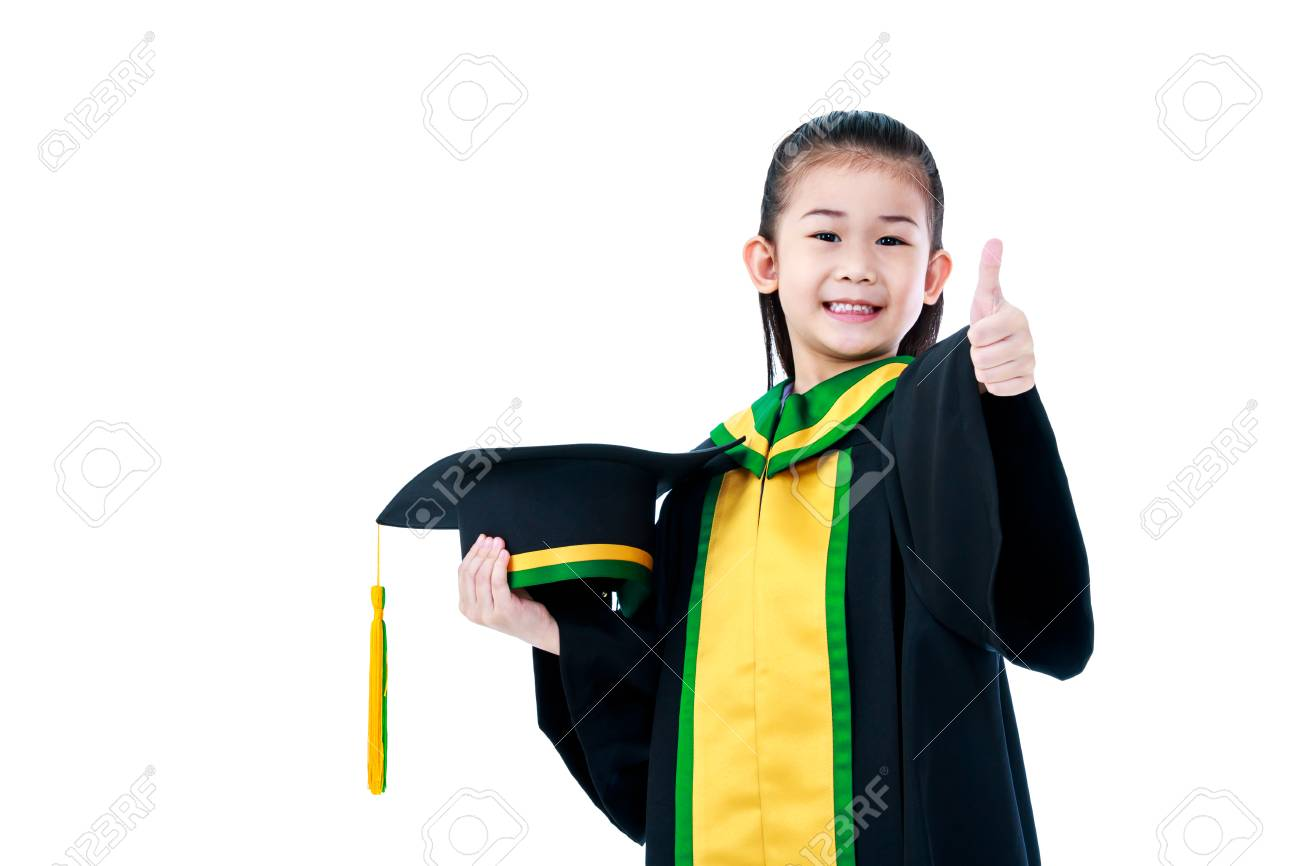 Kindergarten Graduation Happy Asian Child In Gown Holding Cap And Showing Thumb Up Sign