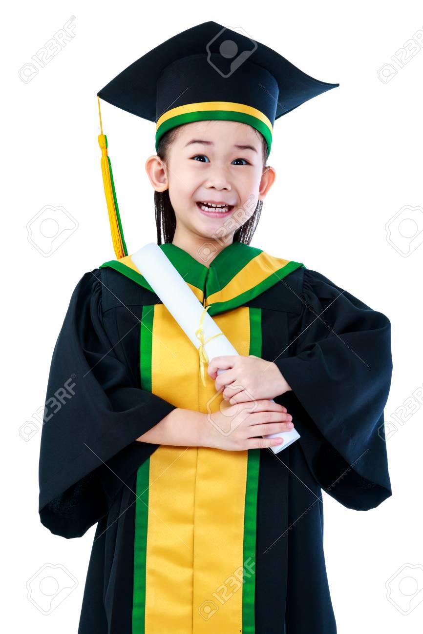 Kindergarten Graduation. Happy Asian Child In Graduation Gown ...