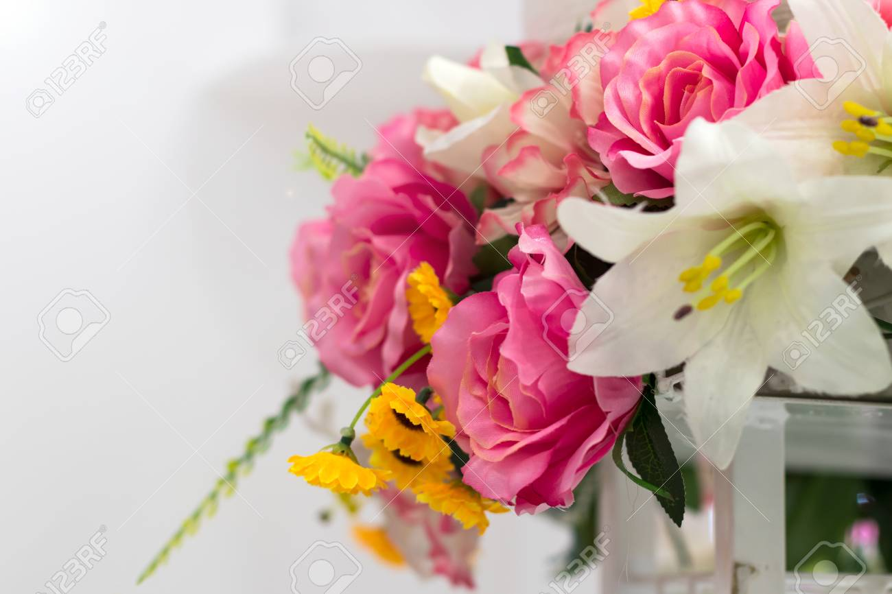 Fake flowers pink roses and other beautiful blooming areas stock fake flowers pink roses and other beautiful blooming areas with white backdrop stock izmirmasajfo