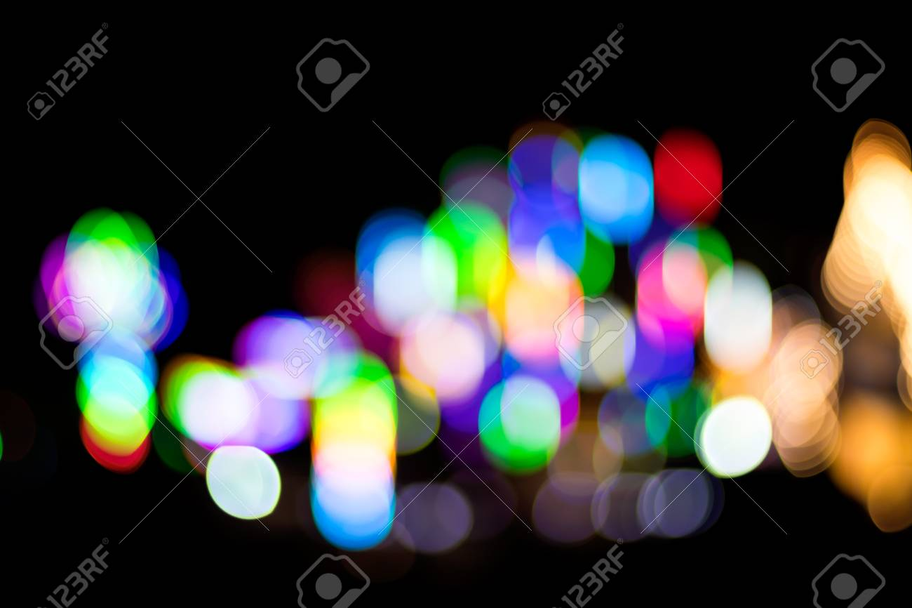 Abstract blurred bokeh lighting a lot of chaotic but beautiful colorful in the dark