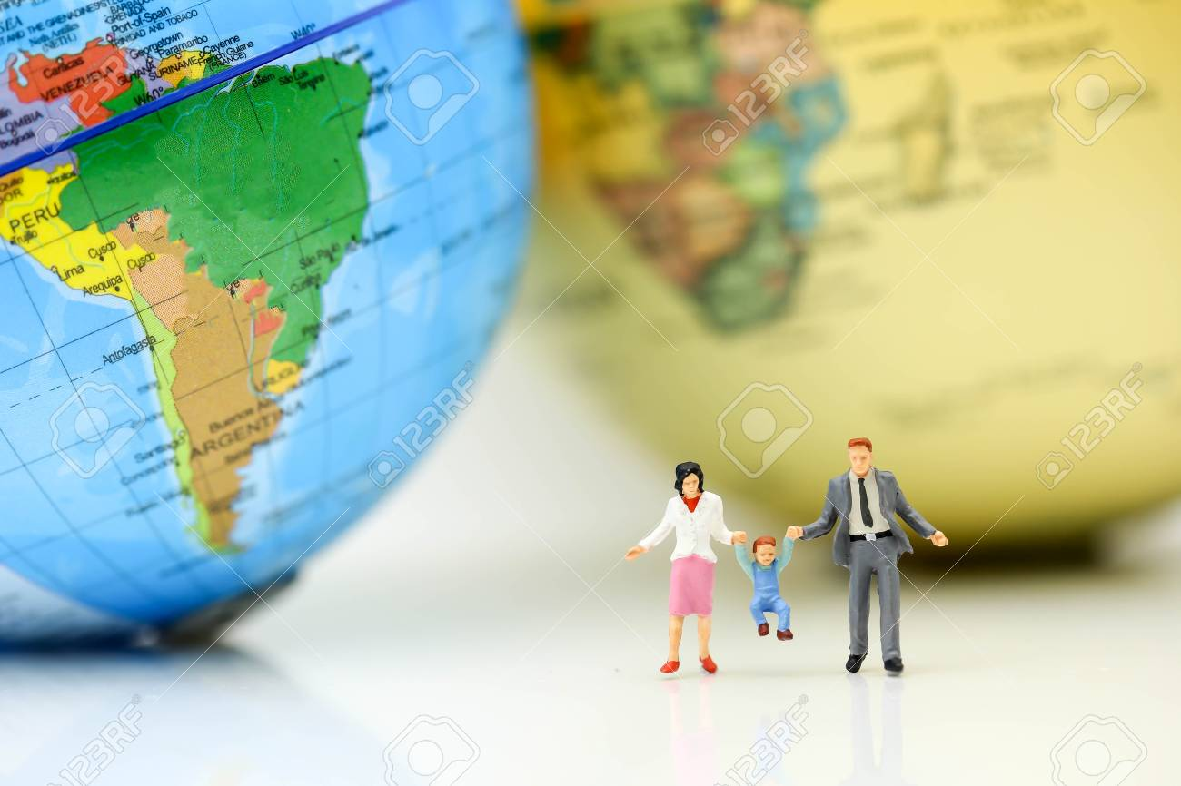 Mini World Map.Miniature People Family With Mini World Map Travel And Family