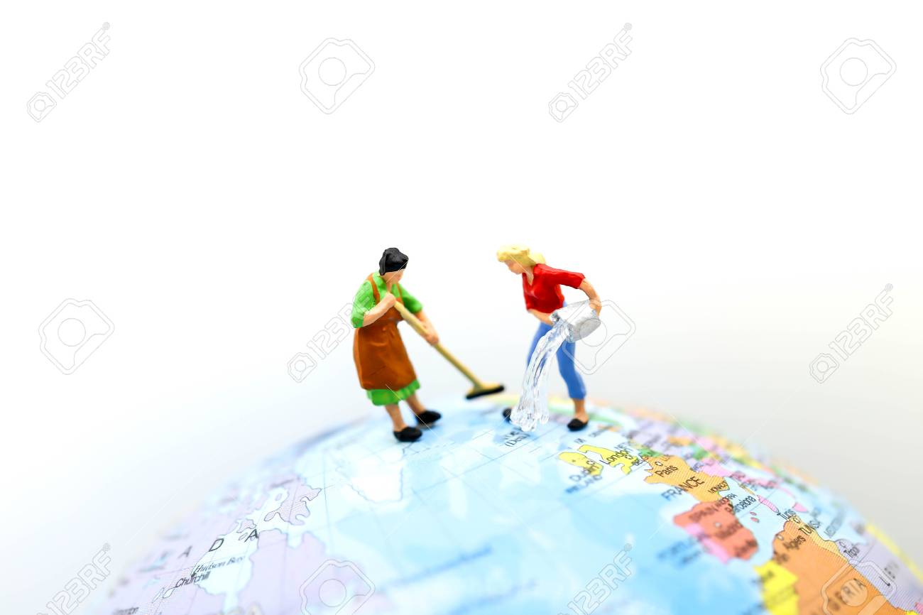 Mini World Map.Miniature People Maid Or Housewife Cleaning On Mini World Map