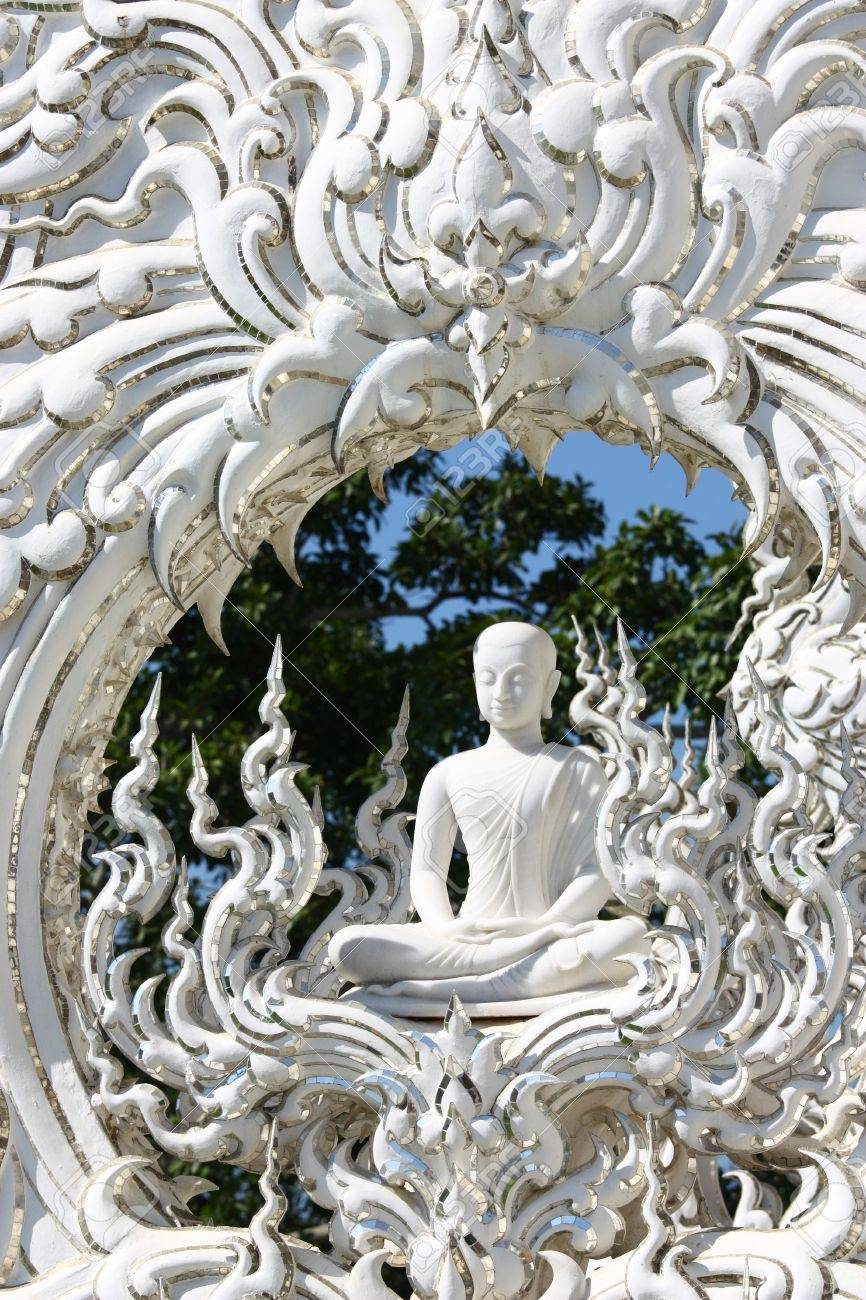White monk meditation statue in Chiangrai Rong Khun temple, northern of Thailand. Stock Photo - 7487035