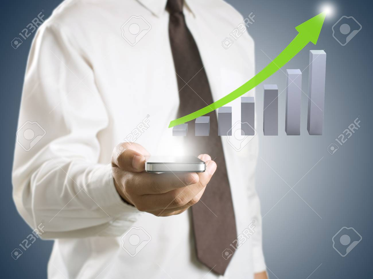 Business man showing smart phone with growth graph in background Stock Photo - 13841060
