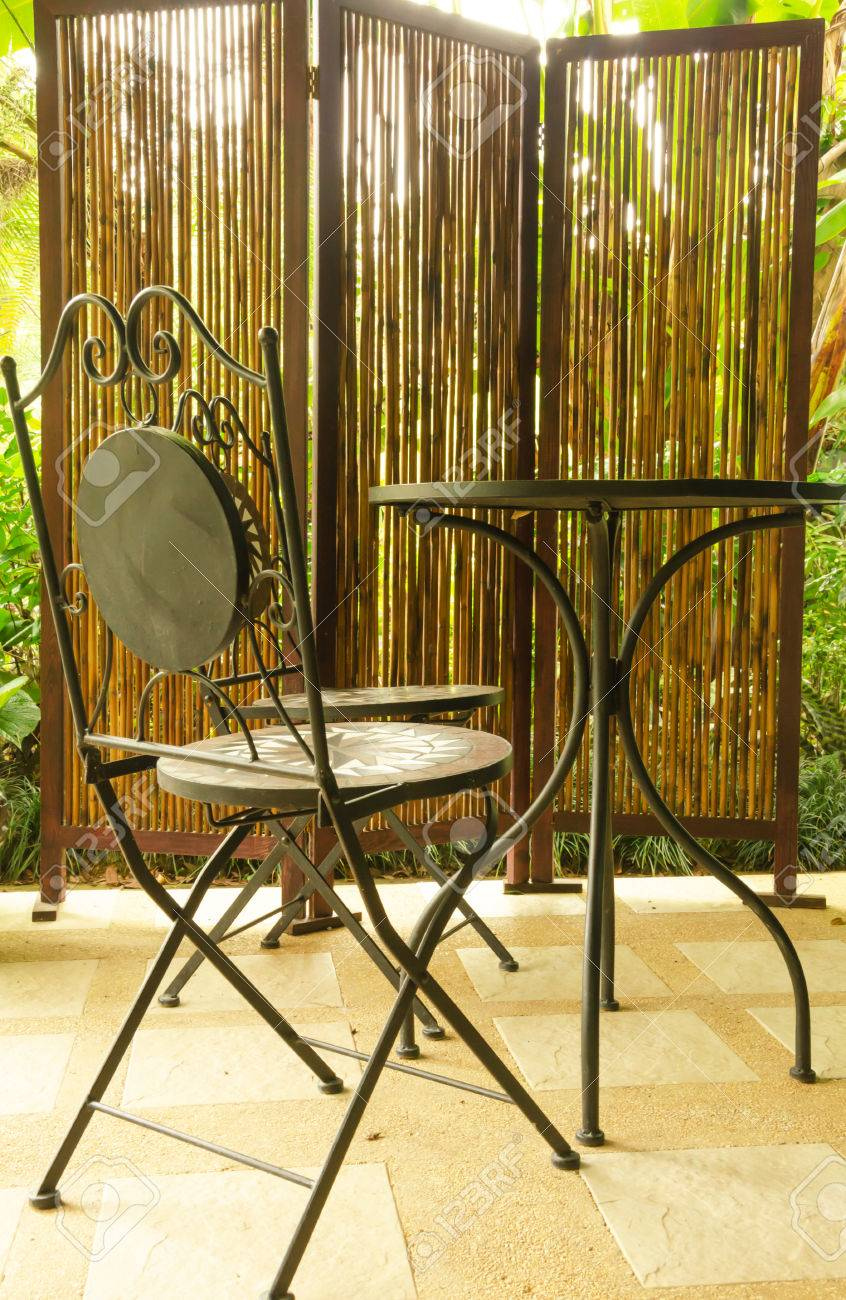 bamboo curtain and steel modern chair and table in coffee shop