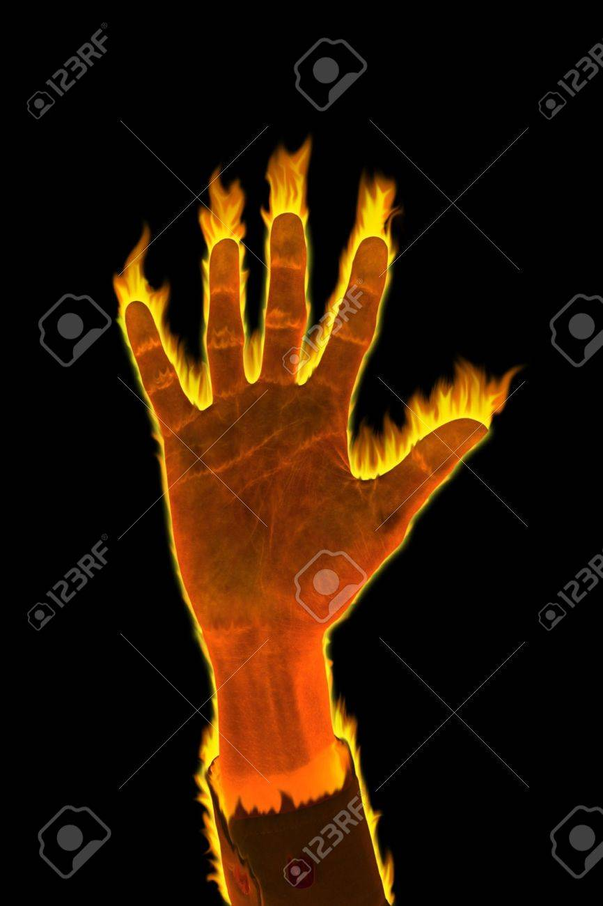 Hand of fire business man glow in the dark. Stock Photo - 12459023