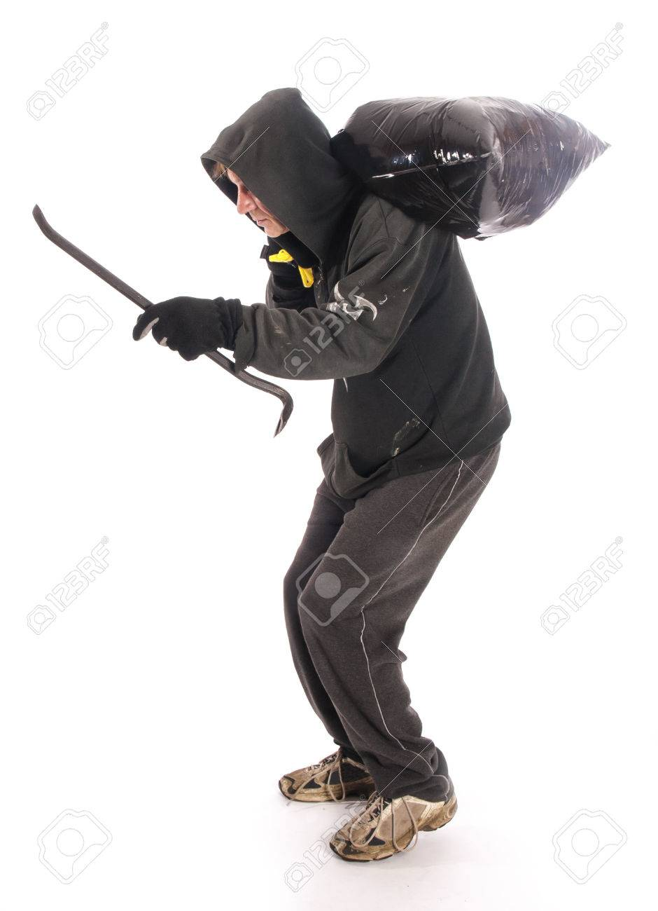 suspicious burgler with crowbar stock photo picture and royalty