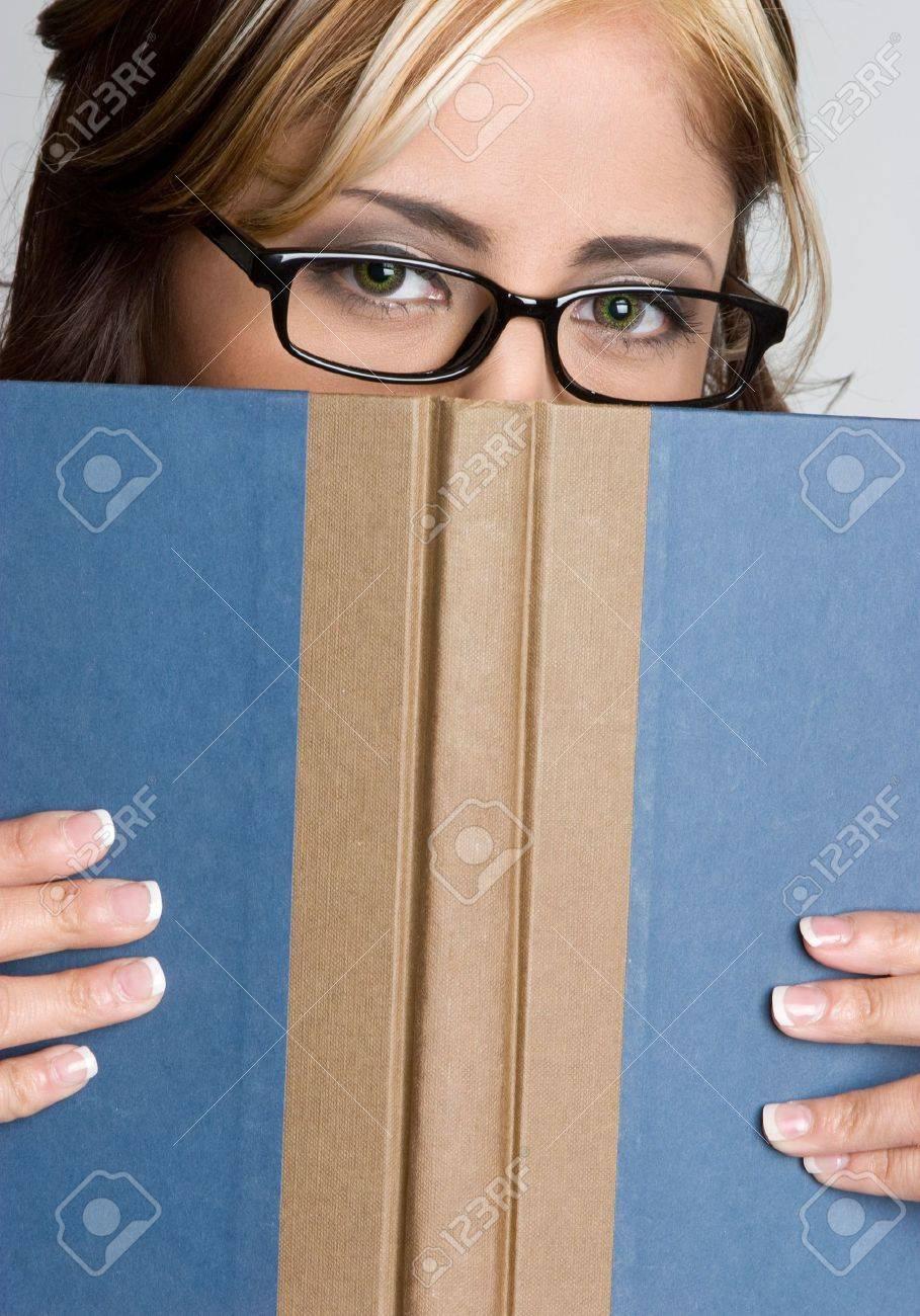 Woman Hiding Behind Book Stock Photo - 4649631